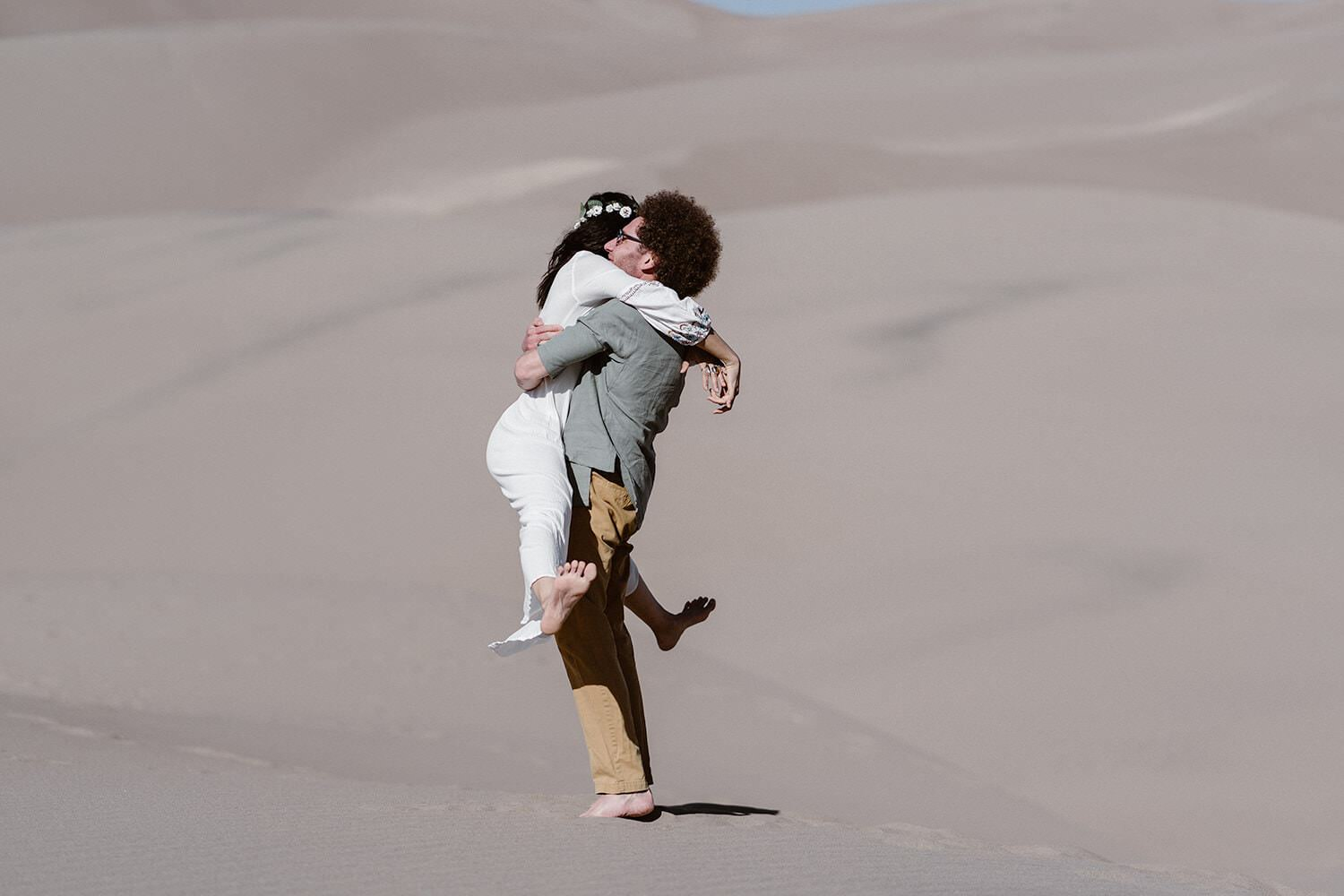 Bride and Groom hugging at Colorado Great Sand Dunes Elopement