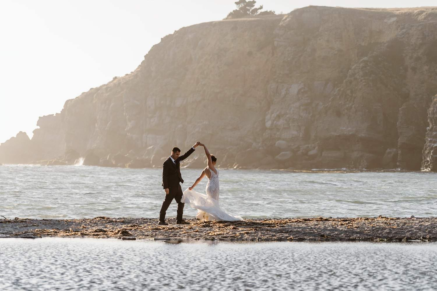 Bride and Groom Dancing on beach at Big Sur Elopement Location