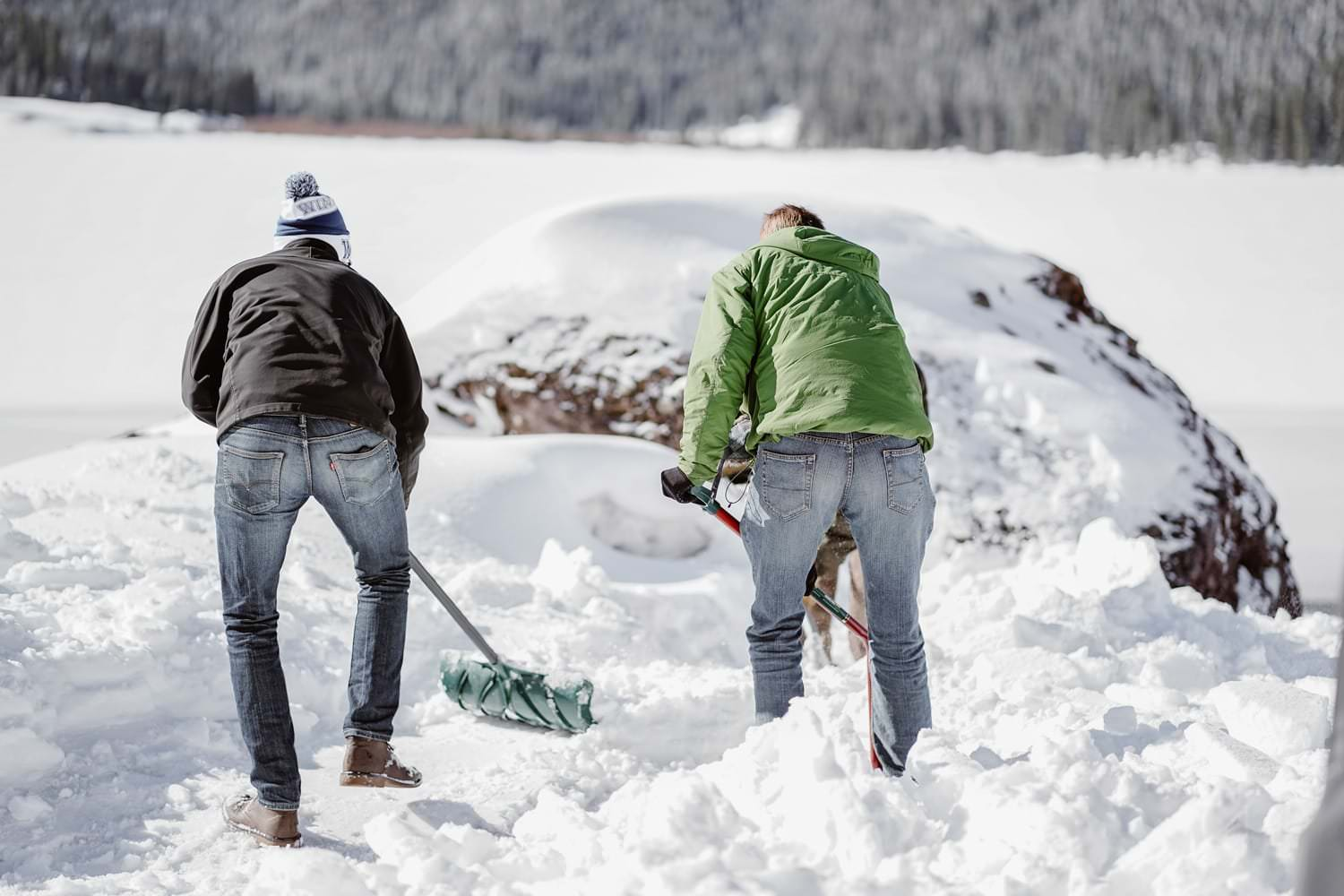 Family Digging Snow in Telluride Elopement