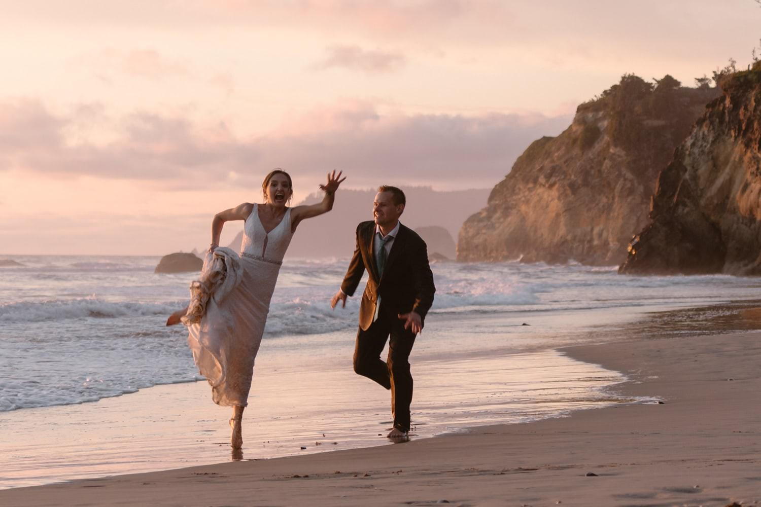 Bride and Groom jumping in the air at Hug Point & Cannon Beach Elopement