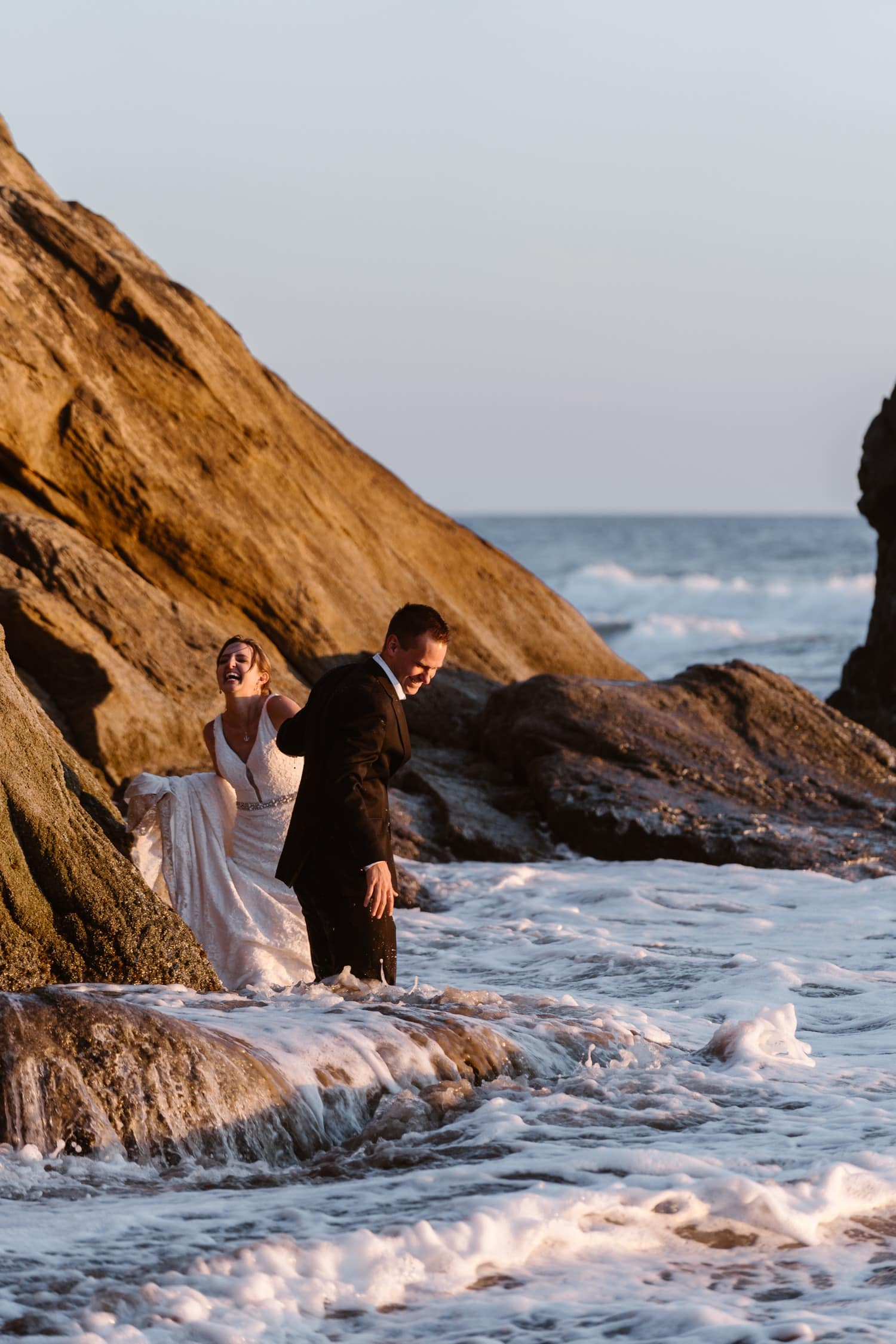 Bride and Groom in the ocean at Hug Point Elopement