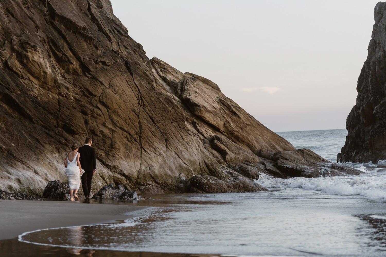 Bride and Groom near ocean at Hug Point & Cannon Beach Elopement