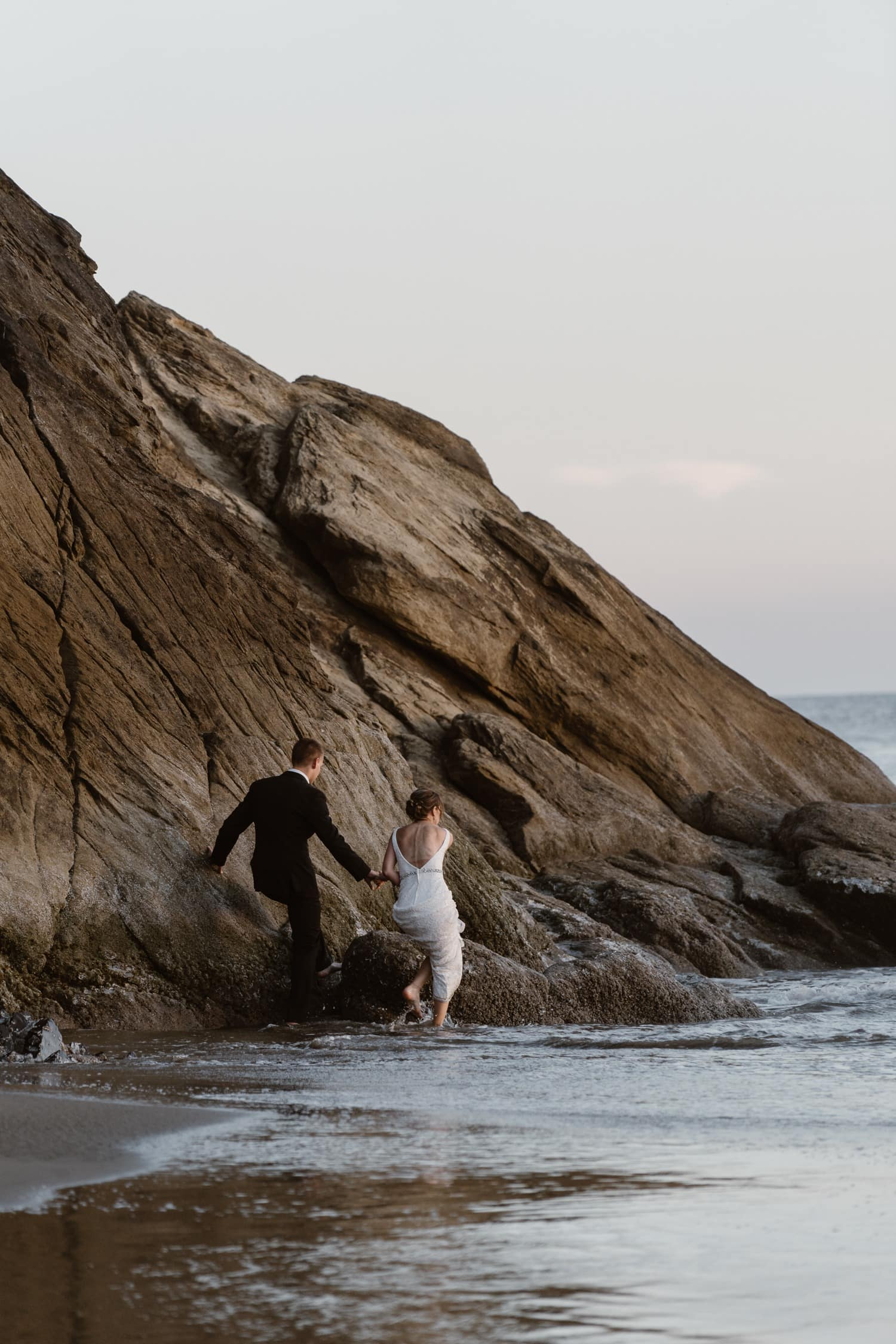 Bride and Groom near ocean at Hug Point & Cannon Beach Elopement