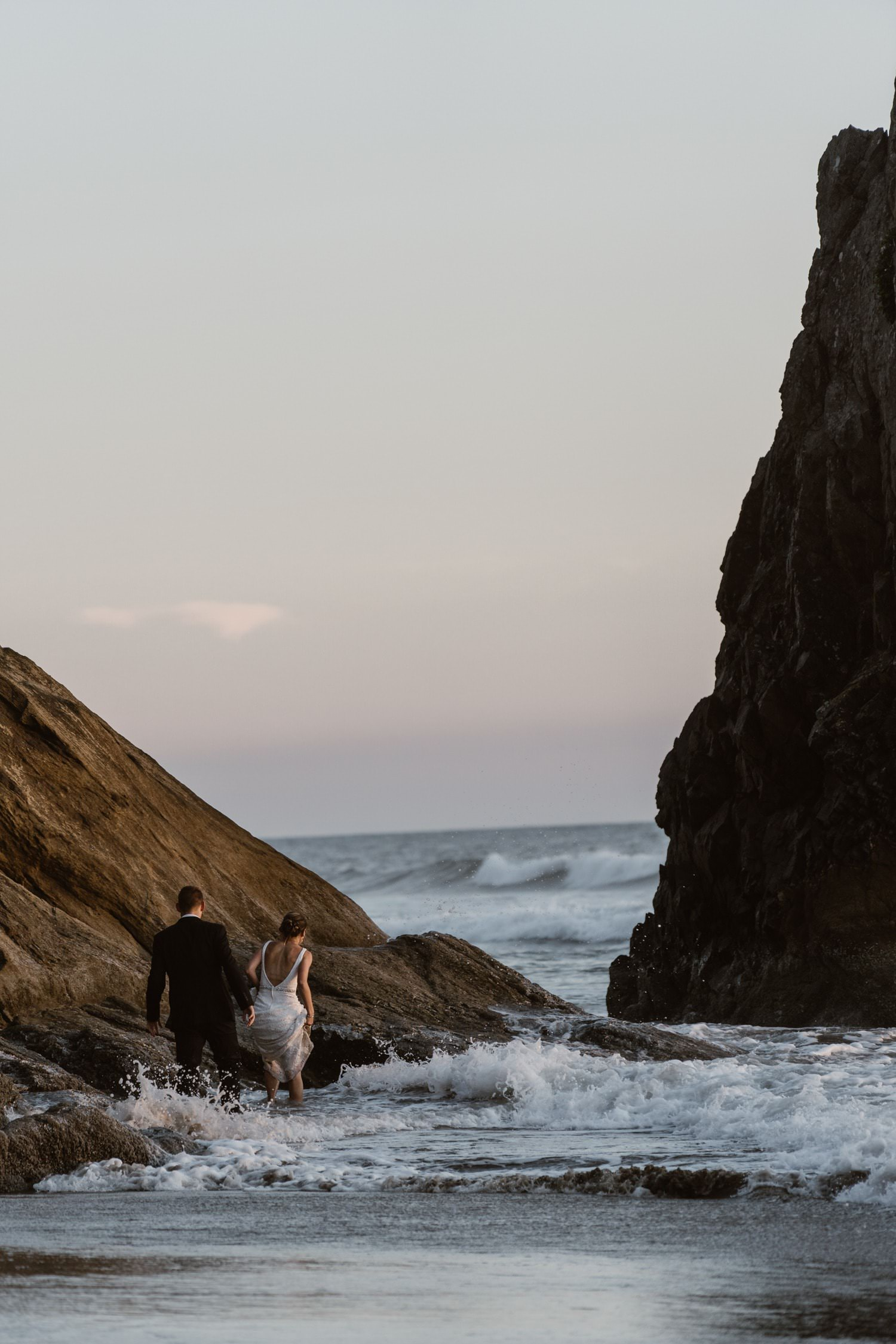 Bride and Groom in the ocean at Hug Point & Cannon Beach Elopement