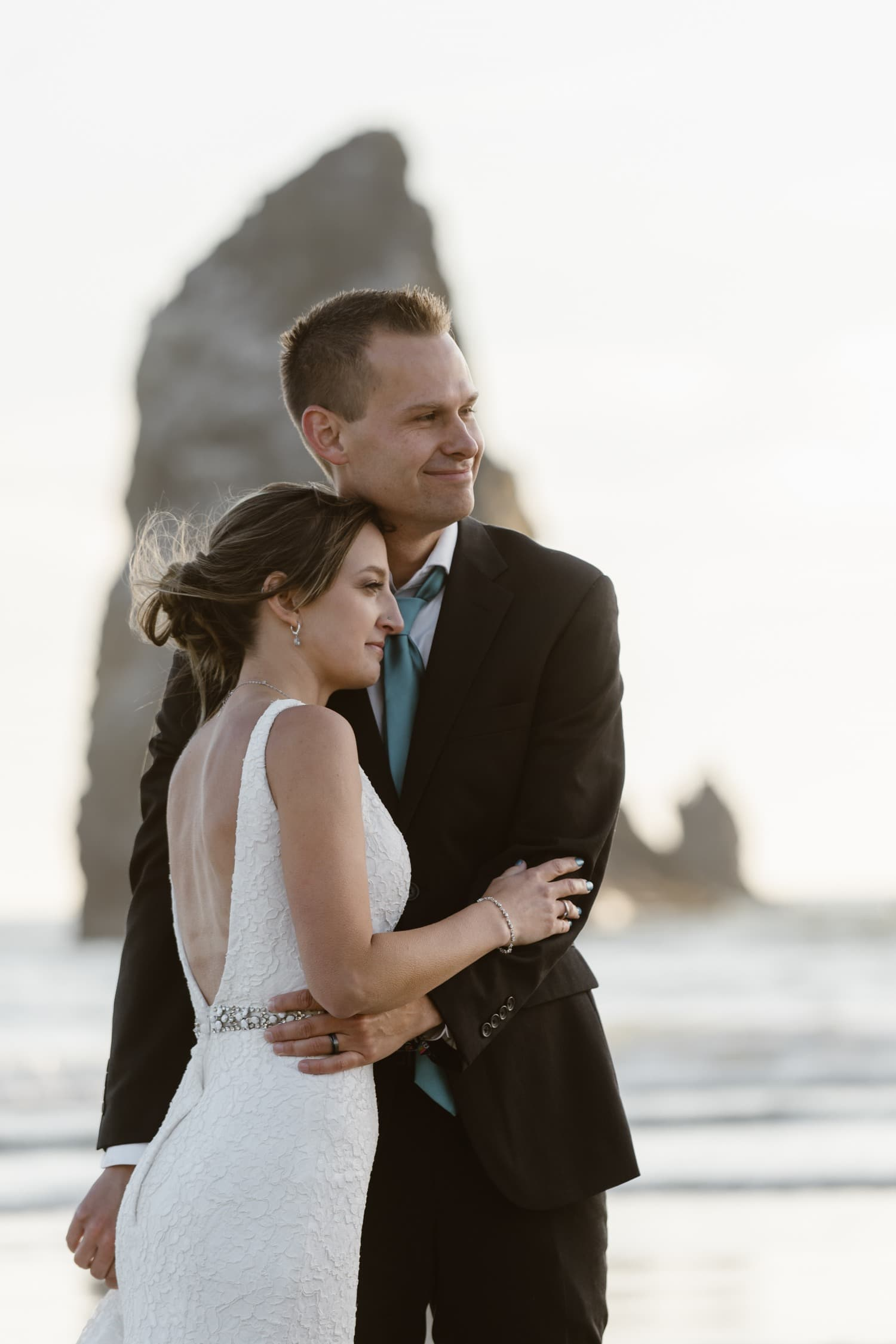 Bride and Groom near Haystack Rock at Cannon Beach Elopement