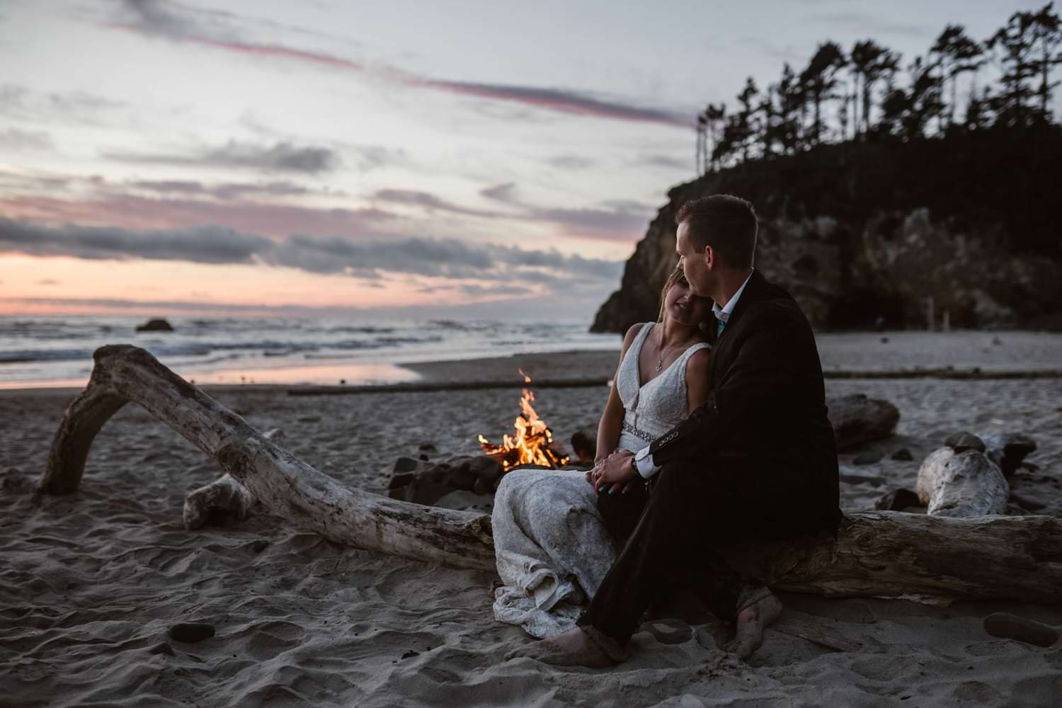 Bride and Groom at Bon Fire at Hug Point & Cannon Beach Elopement