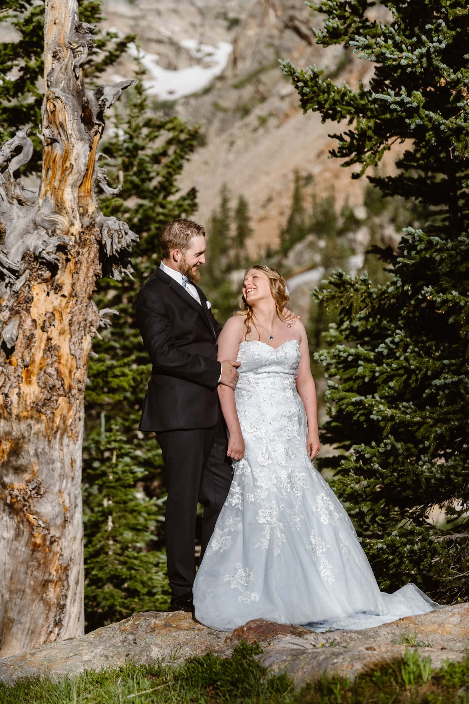Bride and Groom Near Trees at  Colorado Adventure Elopement
