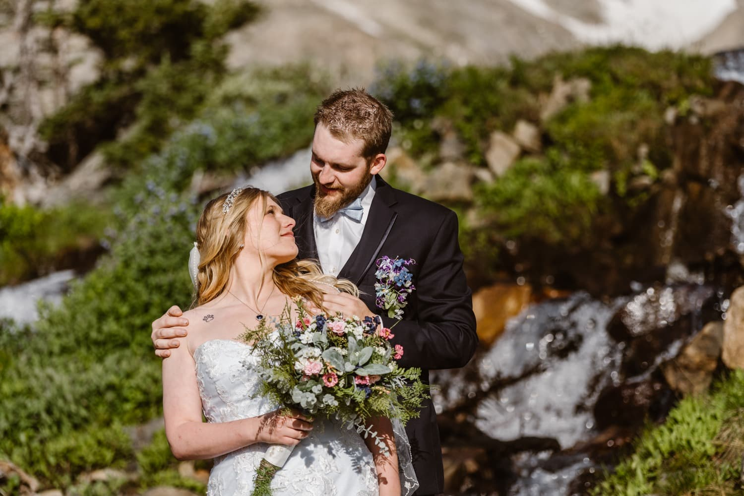 Bride and Groom Near Waterfall at Colorado Adventure Elopement