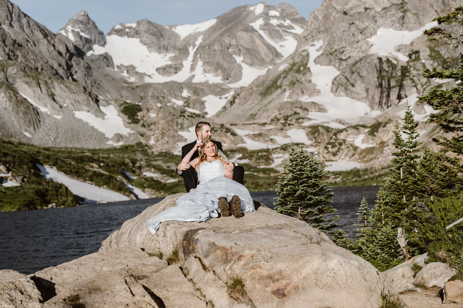Bride and Groom Sitting on Rock at  Adventure Colorado Elopement