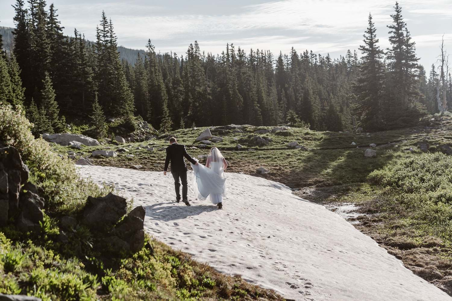 Bride and Groom Hiking at Colorado Adventure Elopement