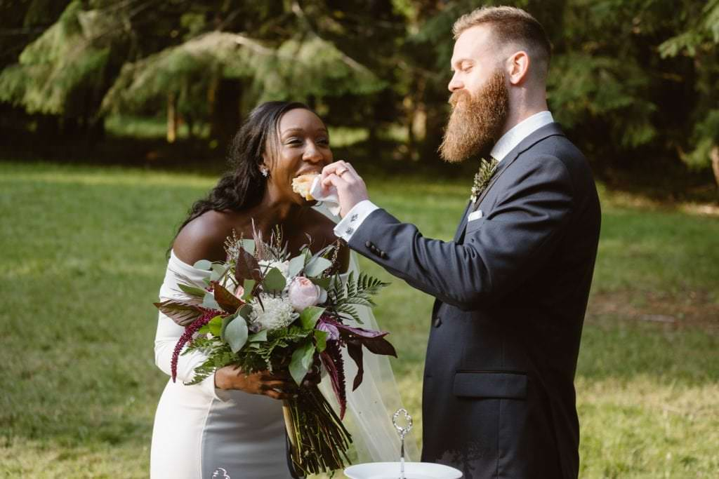 Bride and Groom eating donuts Lake Crescent Elopement