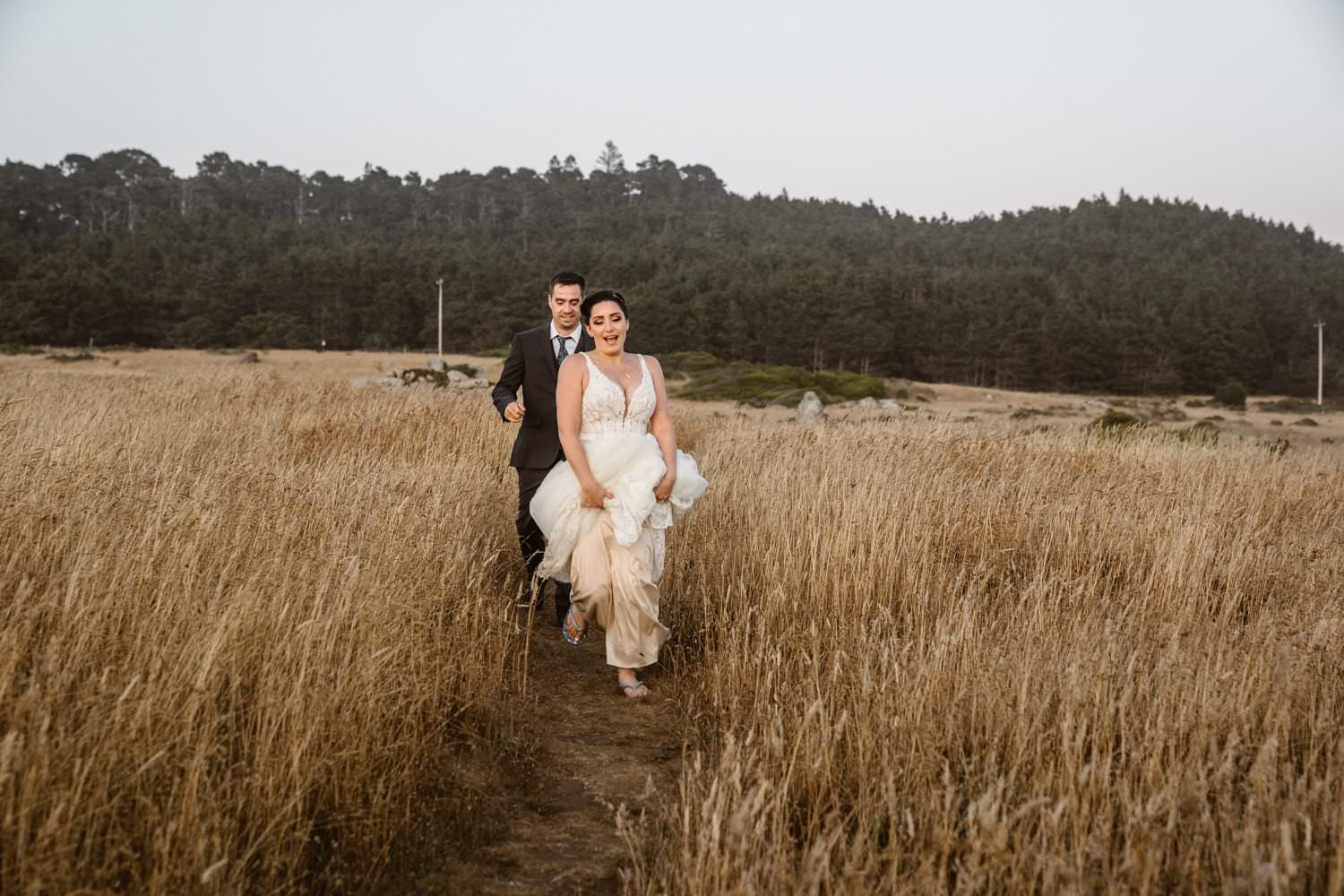 Bride running at Big Sur Elopement