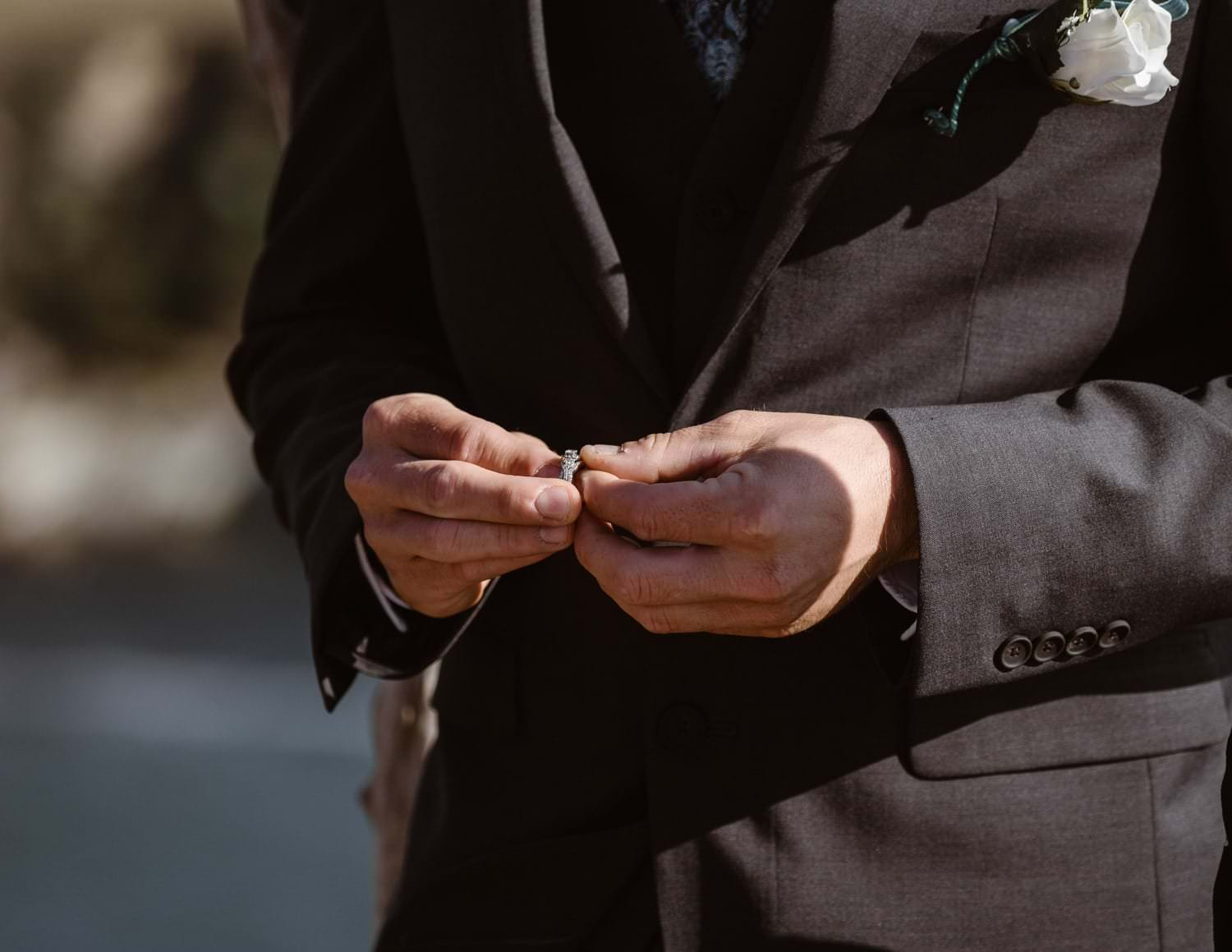 Groom Holding Ring at Big Sur Elopement