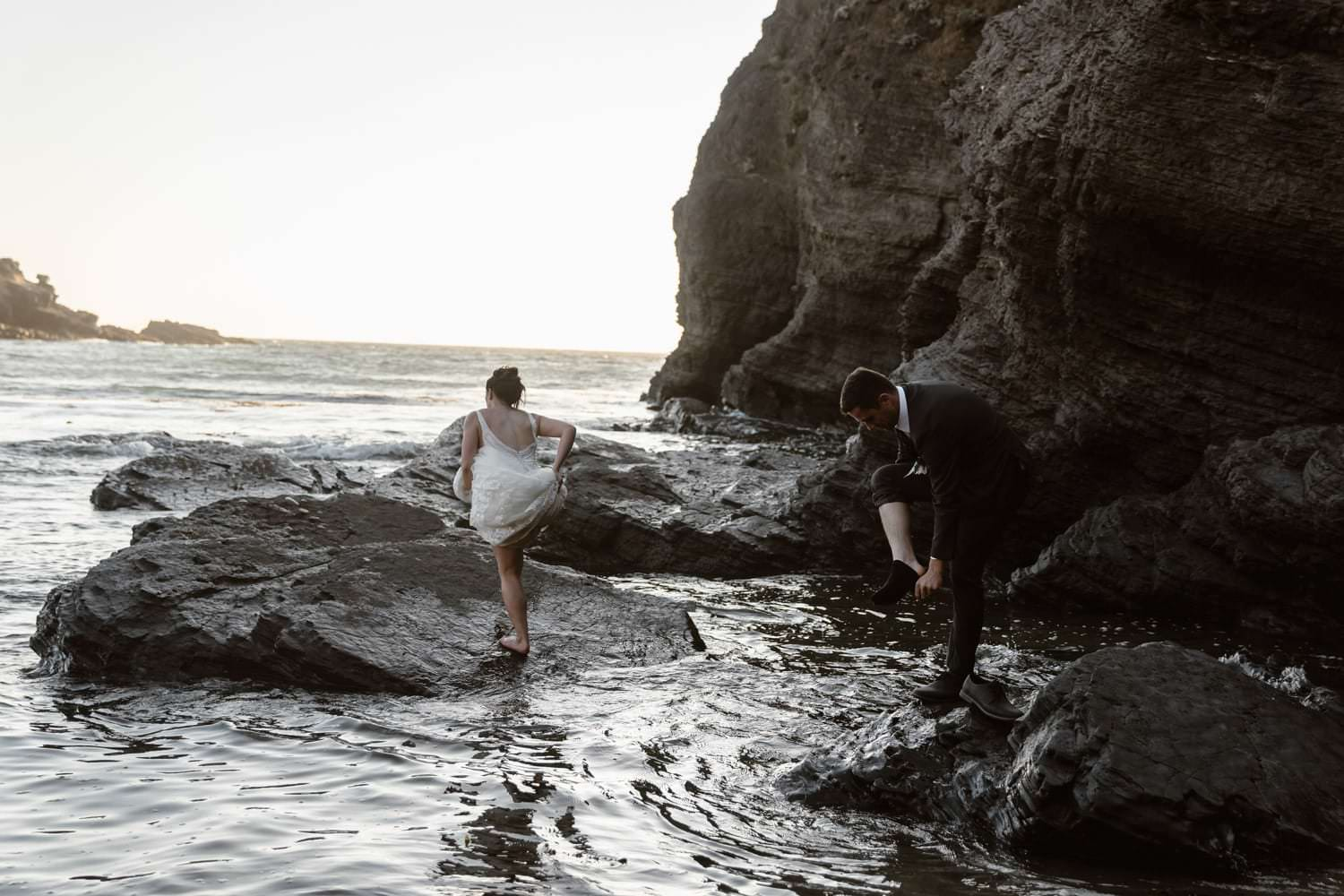 Bride and Groom in the tide pools at Big Sur Elopement