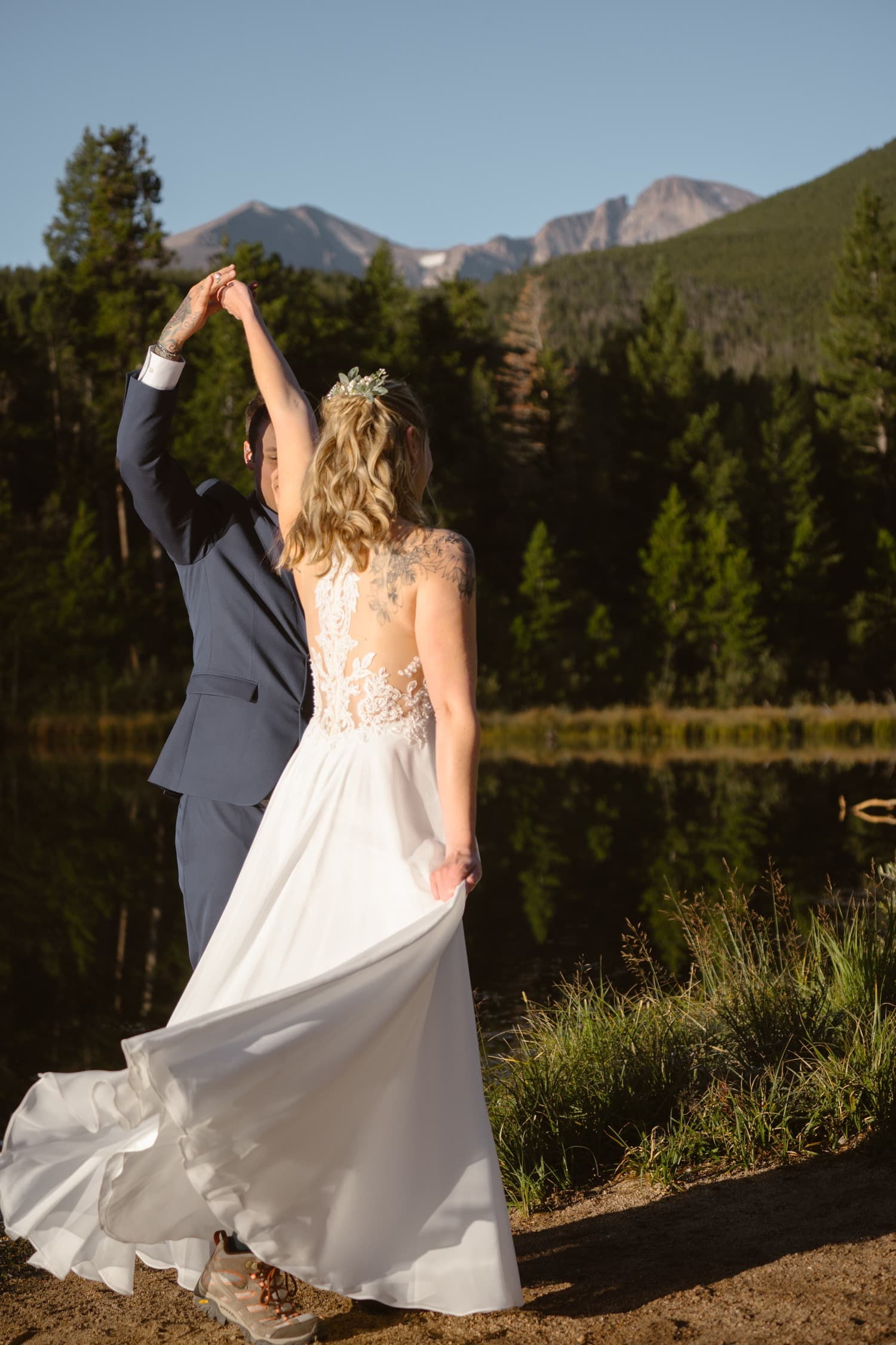 Bride and Groom dancing at Lily Lake Rocky Mountain National Park Elopement