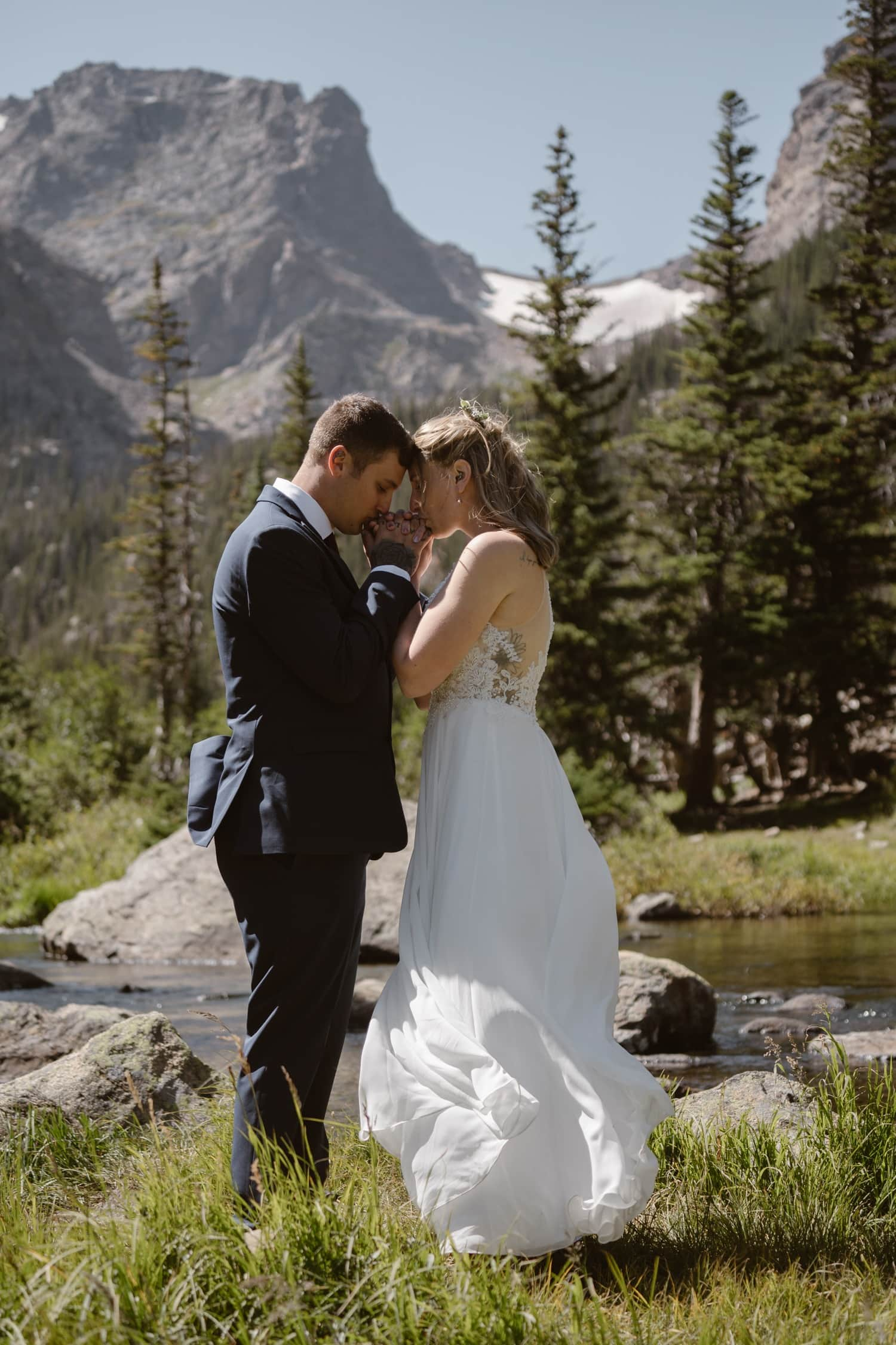 Bride and groom at Loch Lake at Rocky Mountain National Park Hiking Elopement