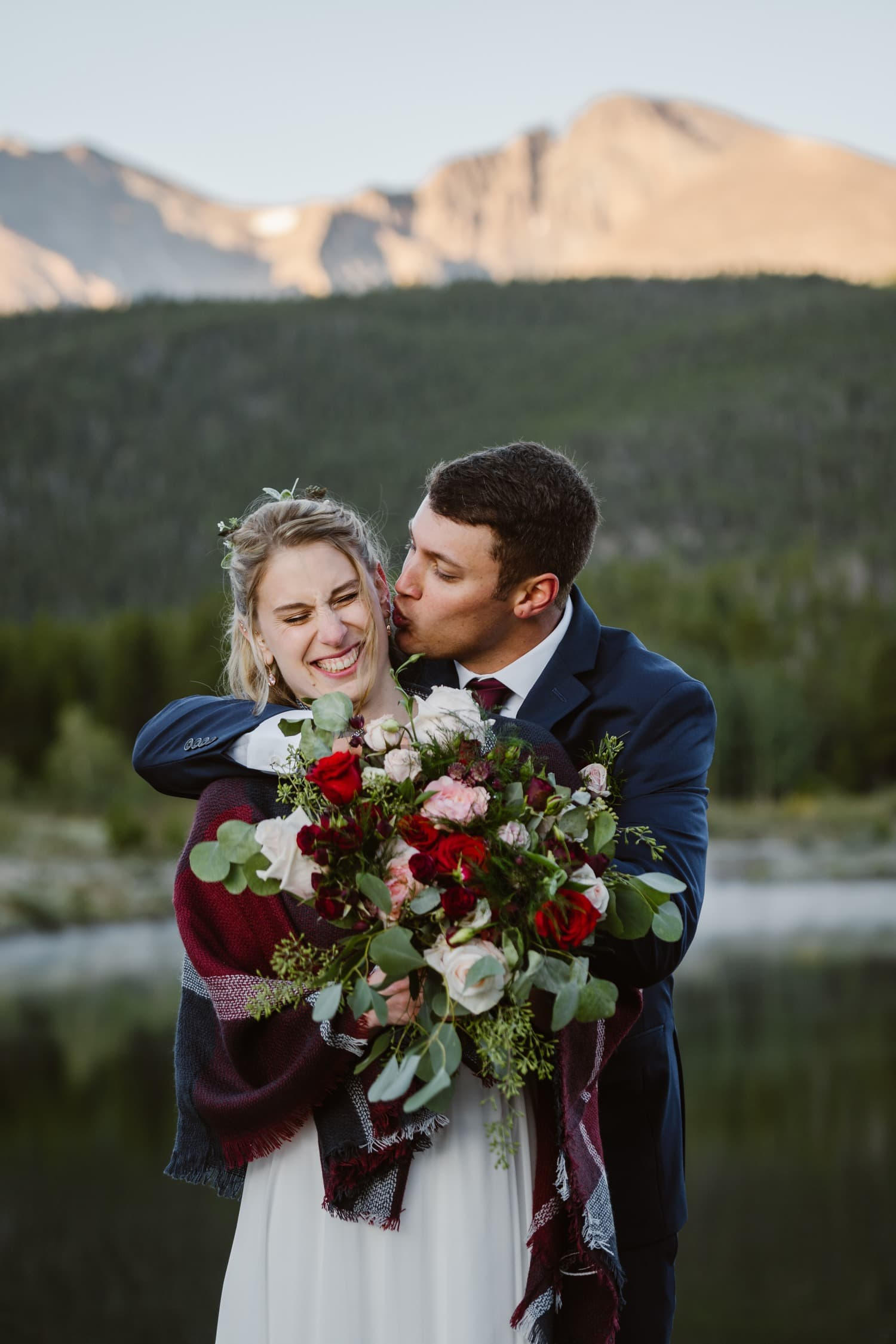 Kisses at Lily Lake Rocky Mountain National Park Elopement