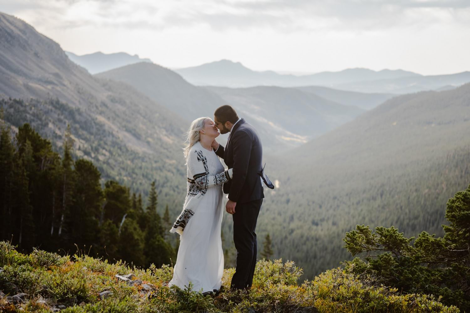 Bride and Groom Kissing Colorado Hiking Elopement