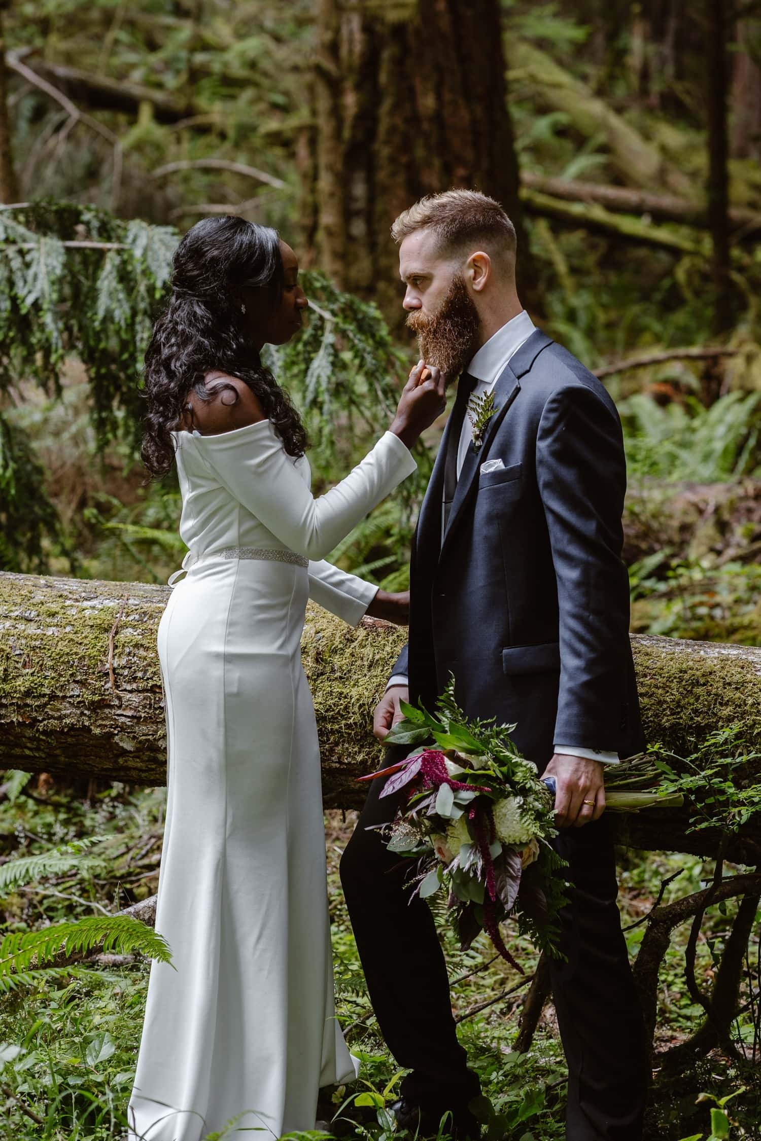 Bride combing beard in forest at  Olympic National Park Elopement