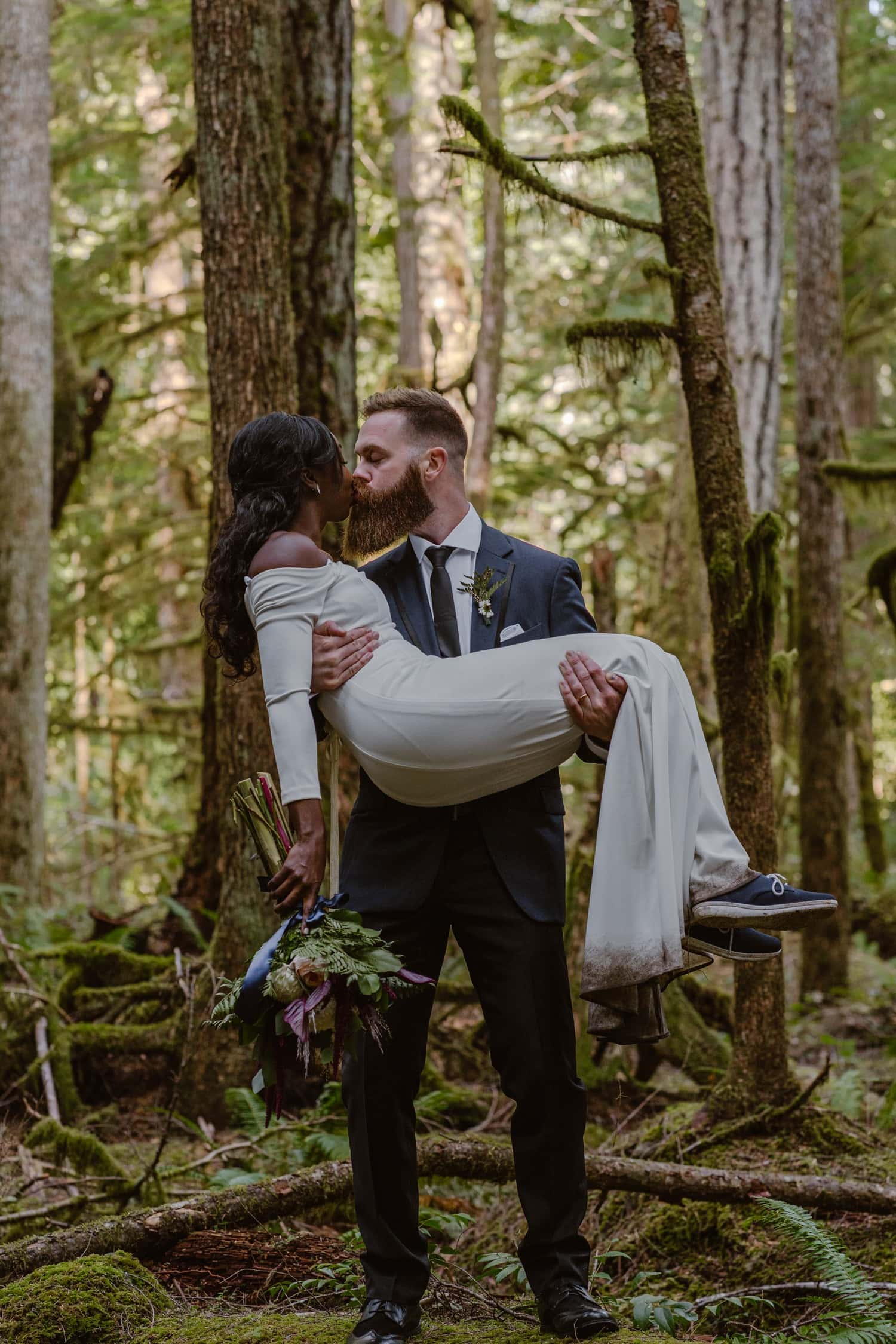 Bride and Groom kissing in forest at  Olympic National Park Elopement