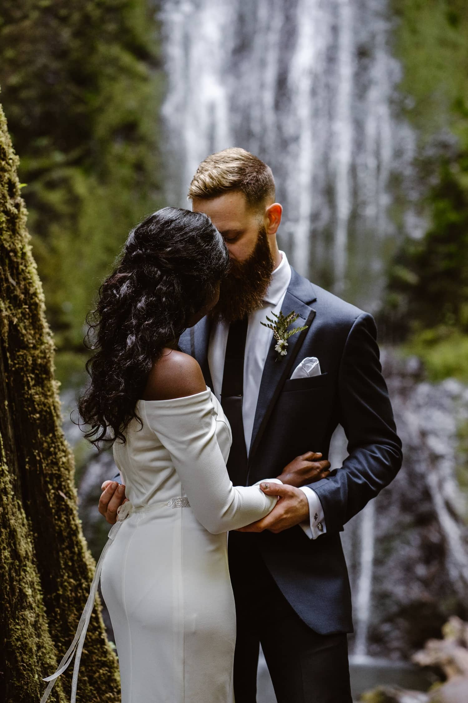 Bride and Groom kissing at waterfall at  Olympic National Park Elopement