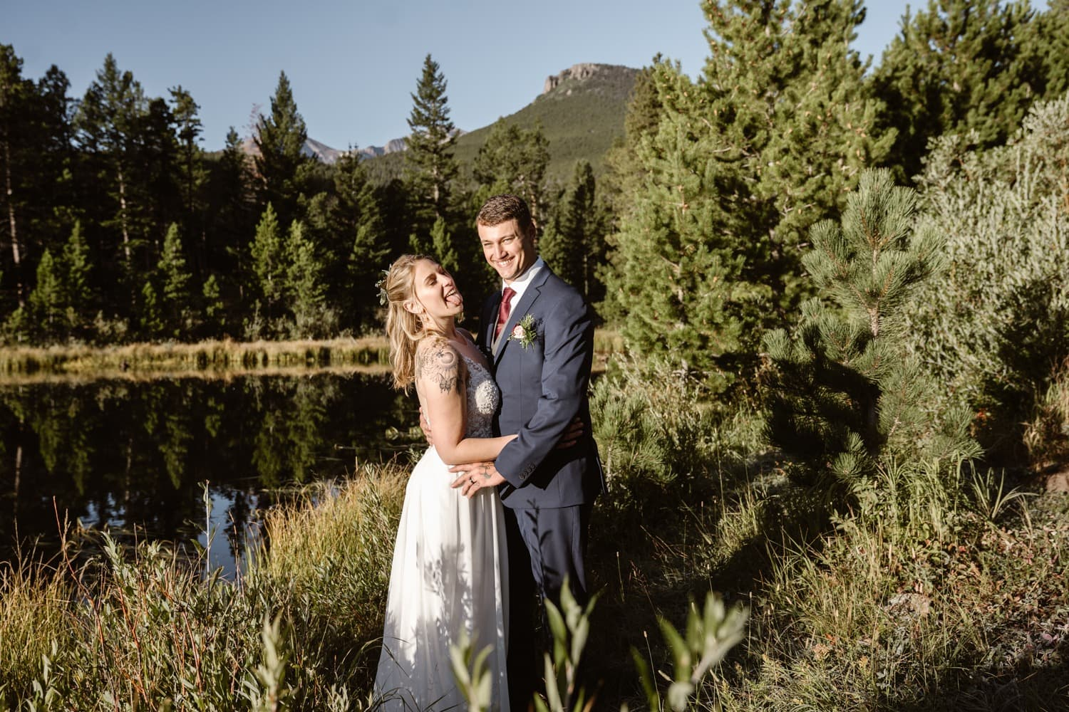 Bride and Groom laughing at Lily Lake Rocky Mountain National Park Elopement