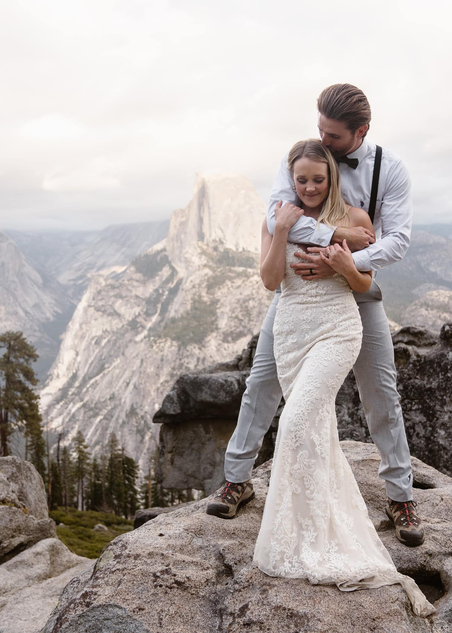 Bride and Groom Hugging at Glacier Point Yosemite Elopement