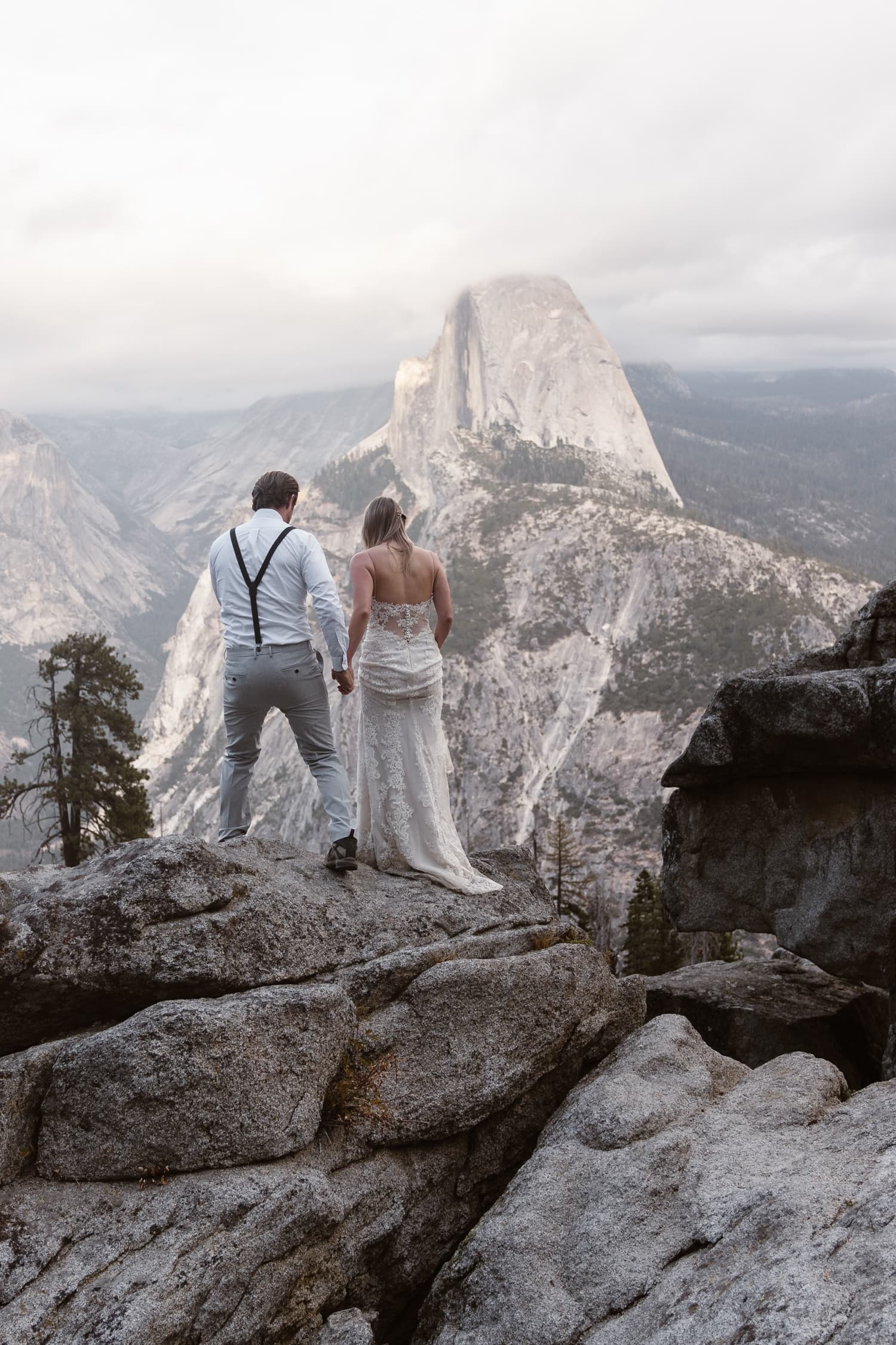 Bride and Groom Hiking at Glacier Point Yosemite Elopement