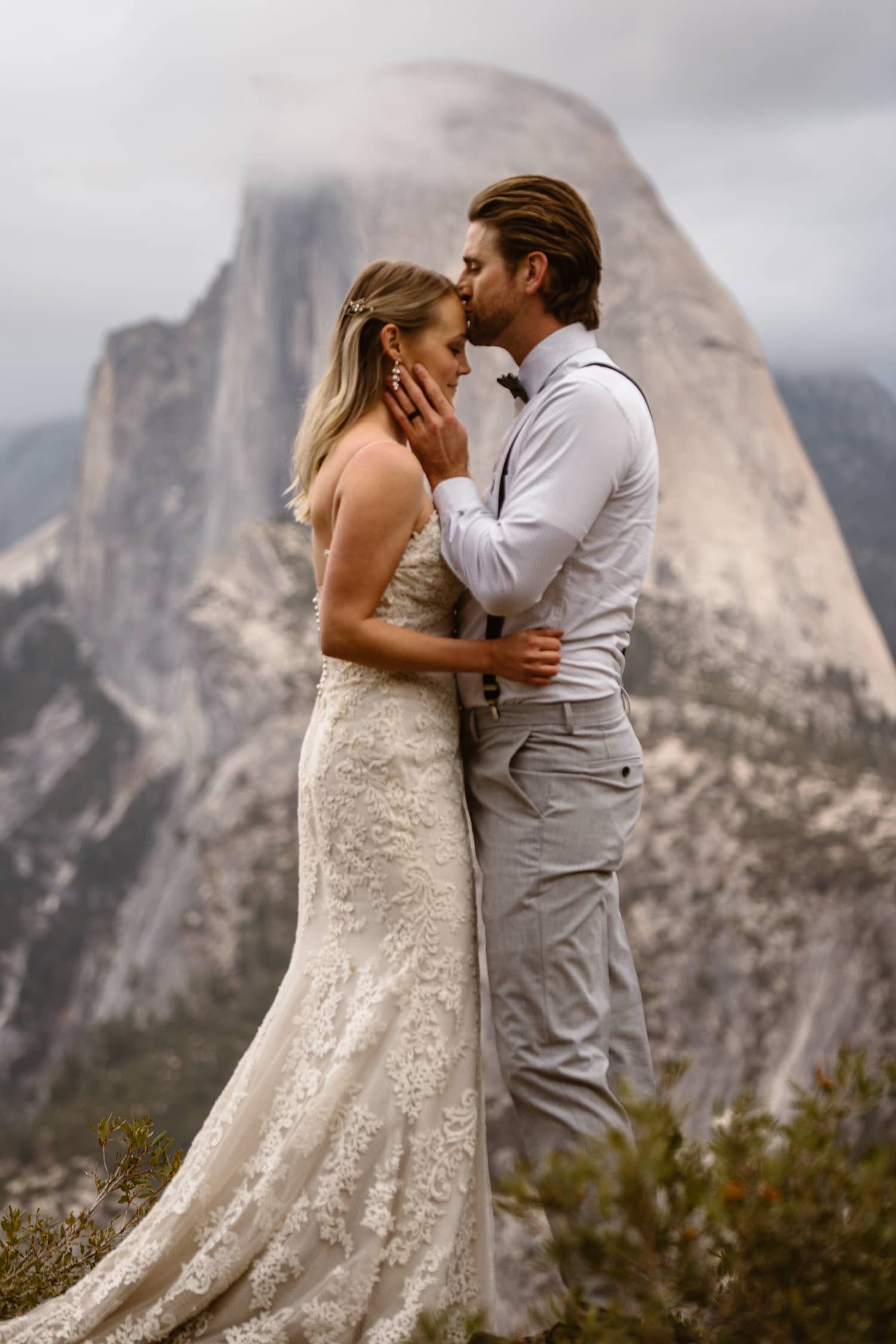 Bride and Groom Kissing at Glacier Point Yosemite Elopement