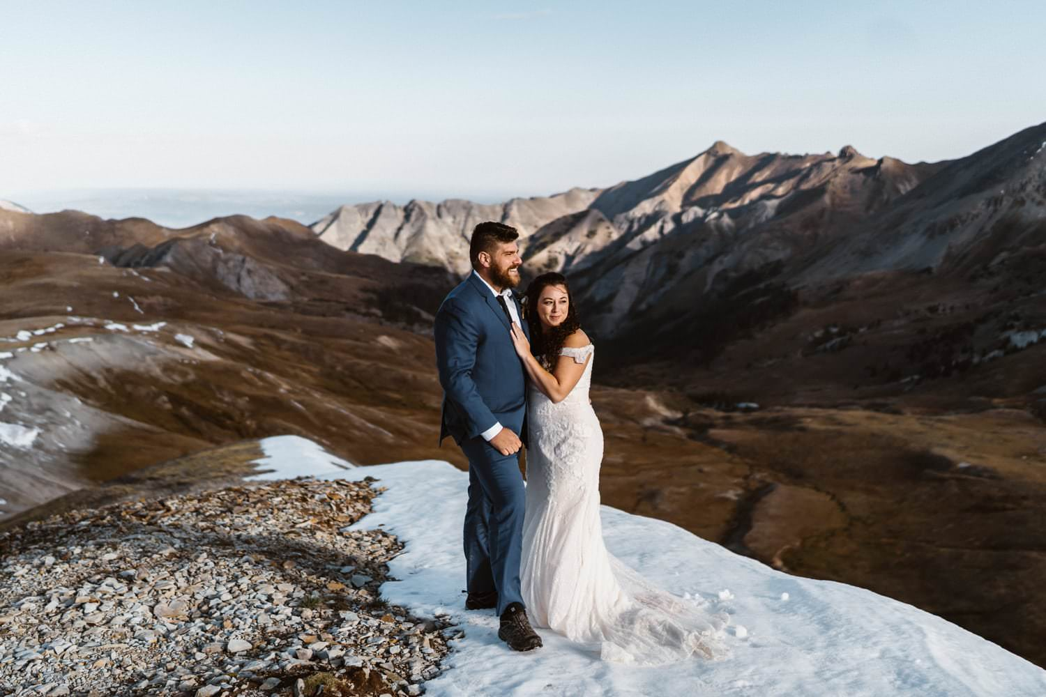 Bride and Groom Hugging Colorado Mountain Elopement Packages
