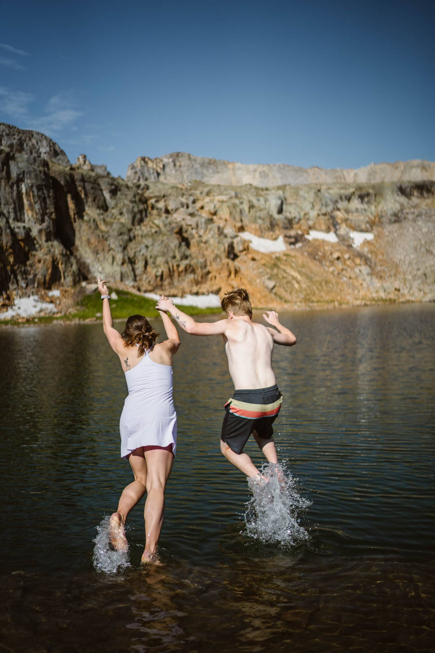 Bride and Groom Jumping In Lake Ouray Colorado Elopement