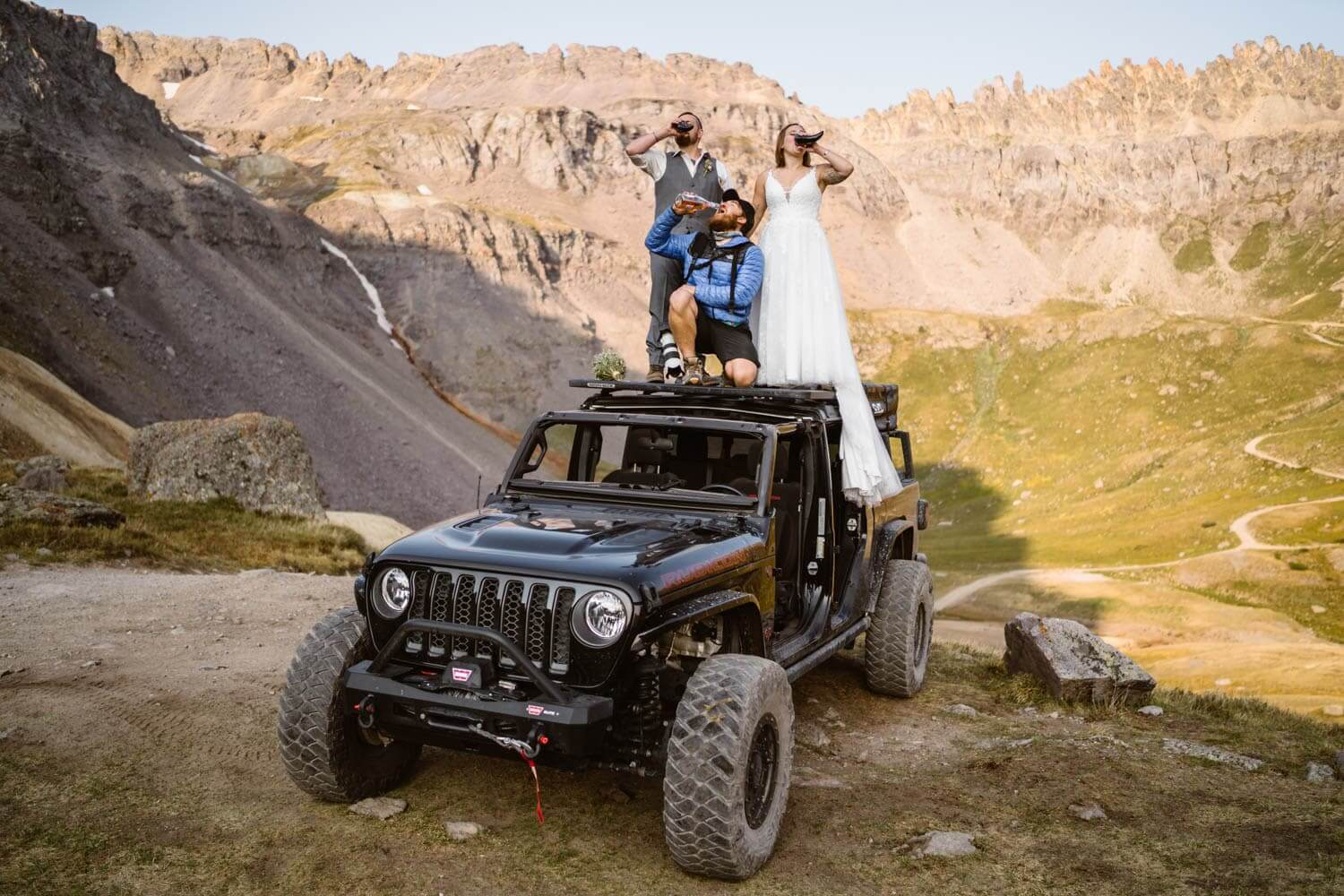 Bride and Groom Drinking Champagne Colorado Off-Roading Elopement