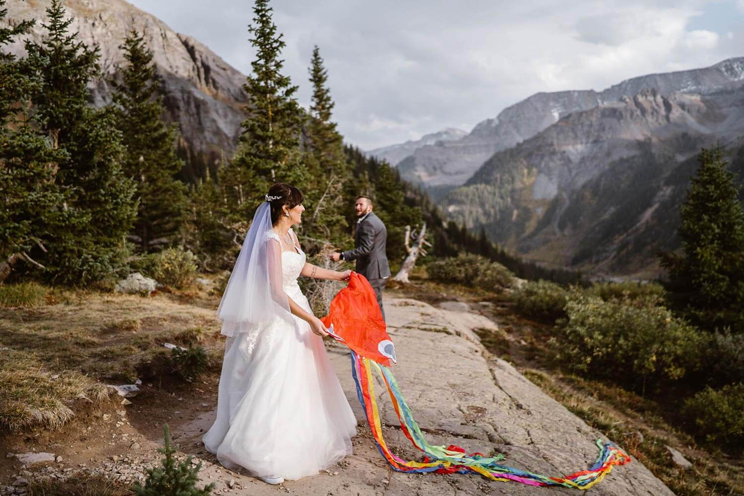 Bride and Groom Flying Kite Telluride Elopement Packages