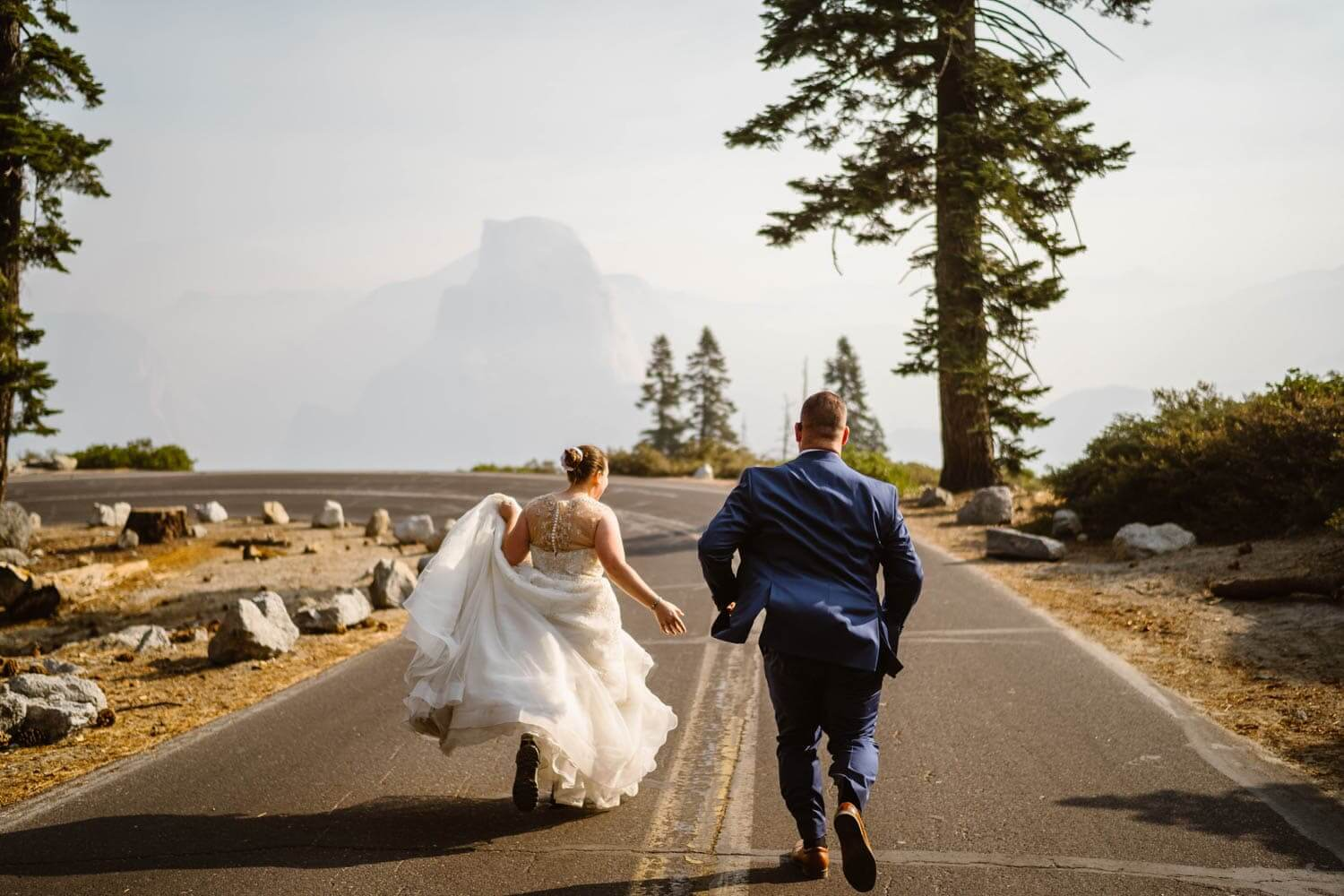 Bride and Groom Running Yosemite Elopement Guide and Packages