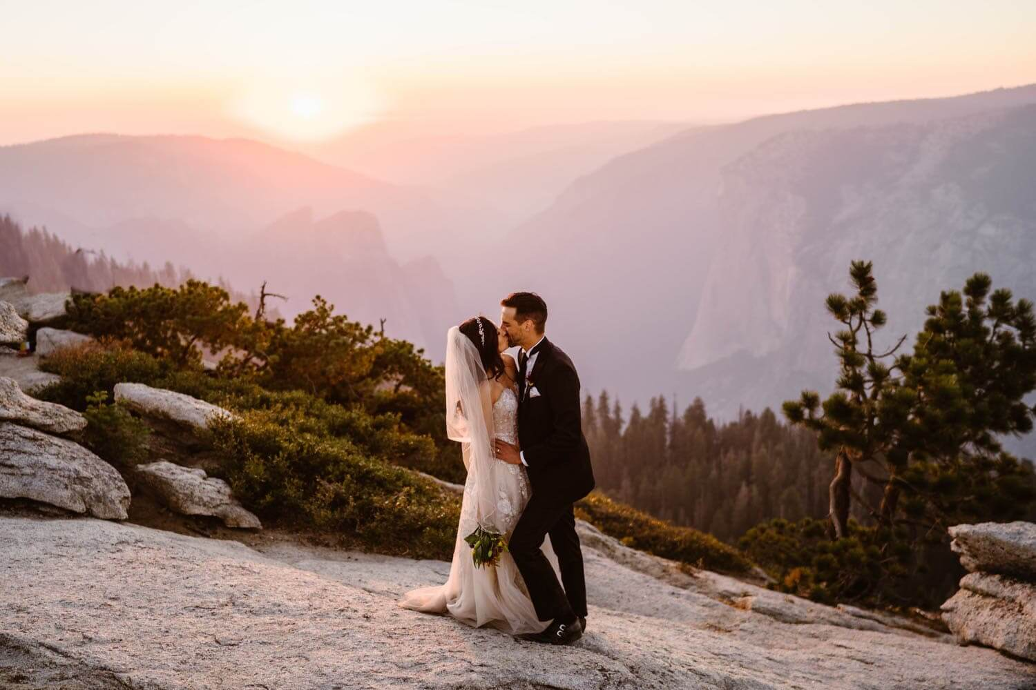 Bride and Groom Kissing Yosemite Elopement Guide and Packages