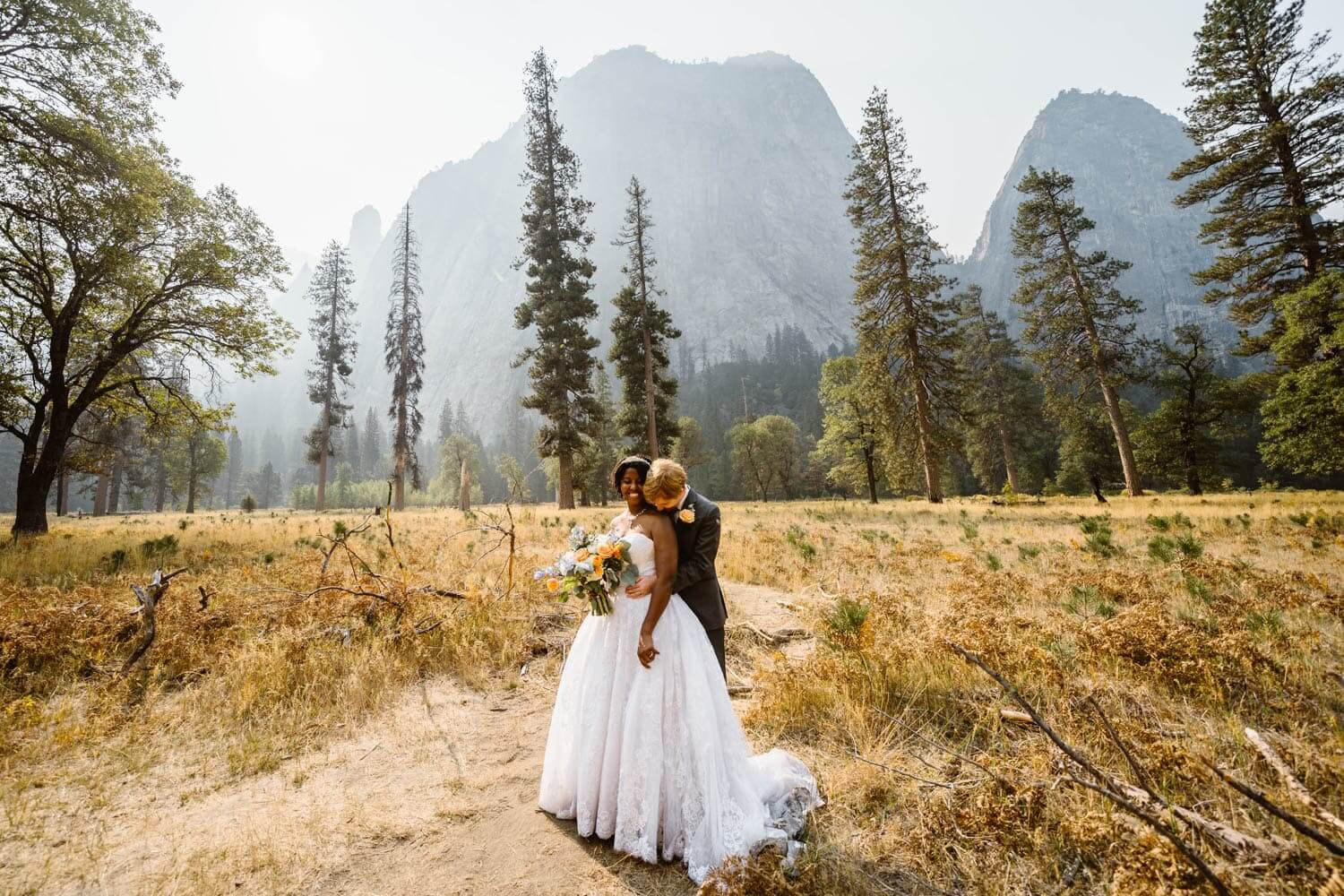 Bride and Groom Hugging Yosemite Elopement Guide and Packages