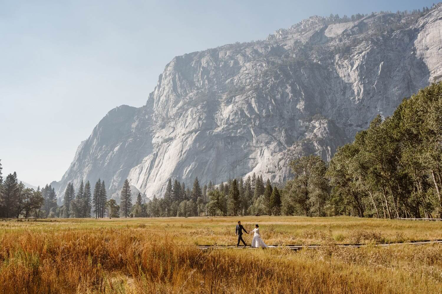 Bride and Groom Walking Yosemite Elopement Guide and Packages