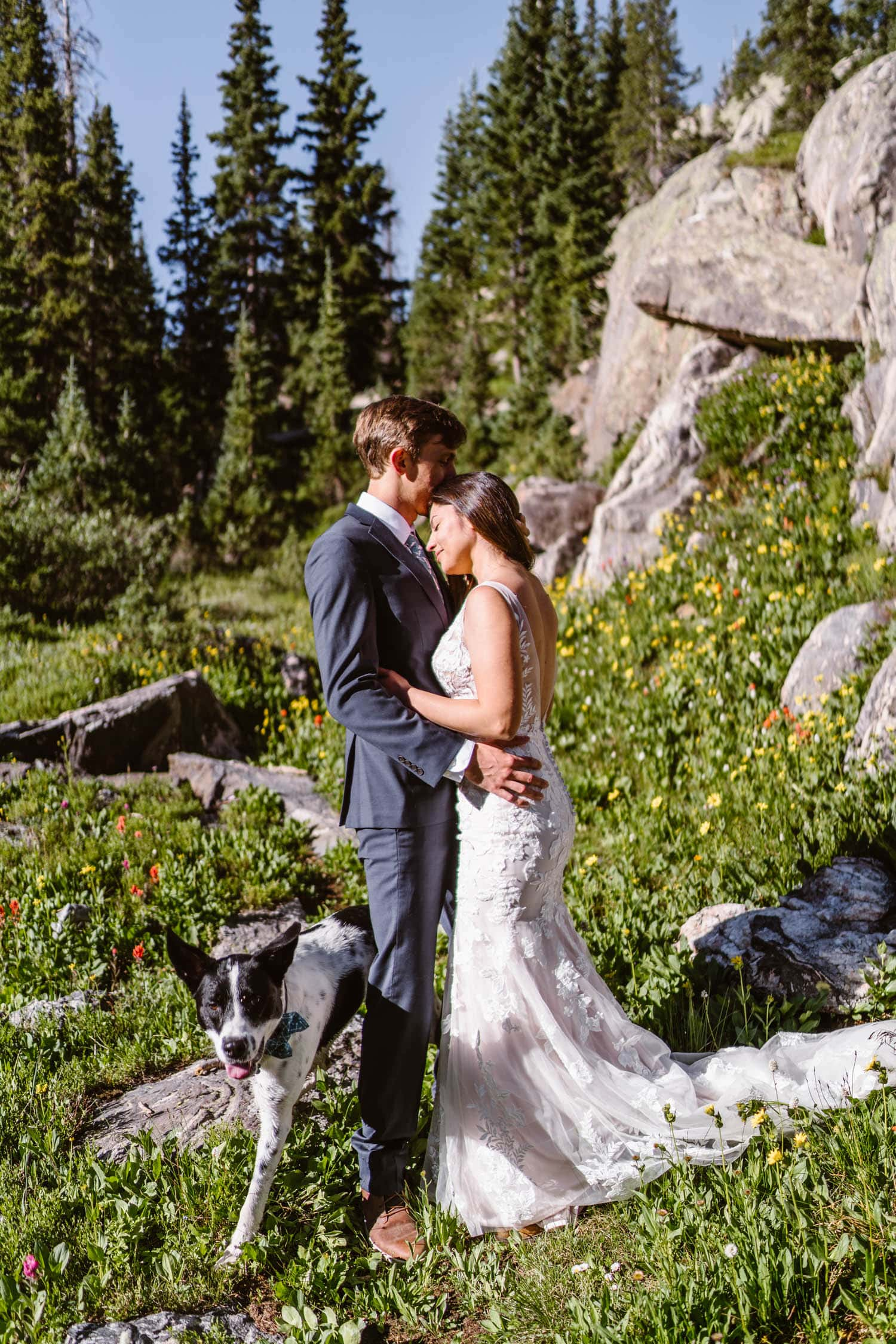 Bride and Groom Near Flowers Grand Lake Colorado Elopement