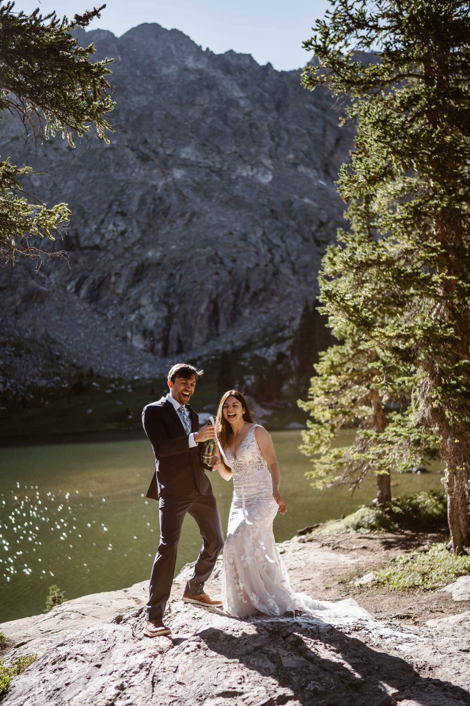 Bride and Groom Popping Champagne Grand Lake Colorado Elopement