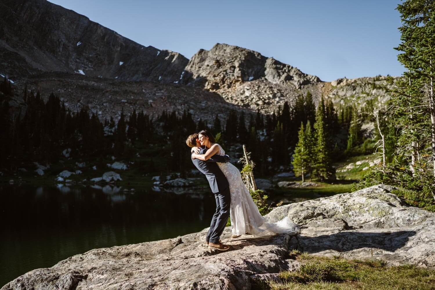 Bride and Groom Hugging Grand Lake Colorado Elopement