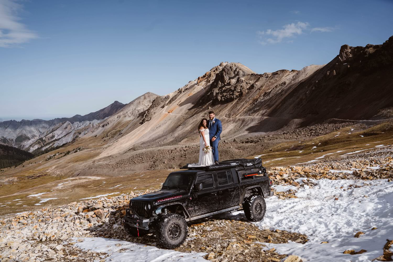 Bride and Groom on Jeep at Silverton, CO Elopement