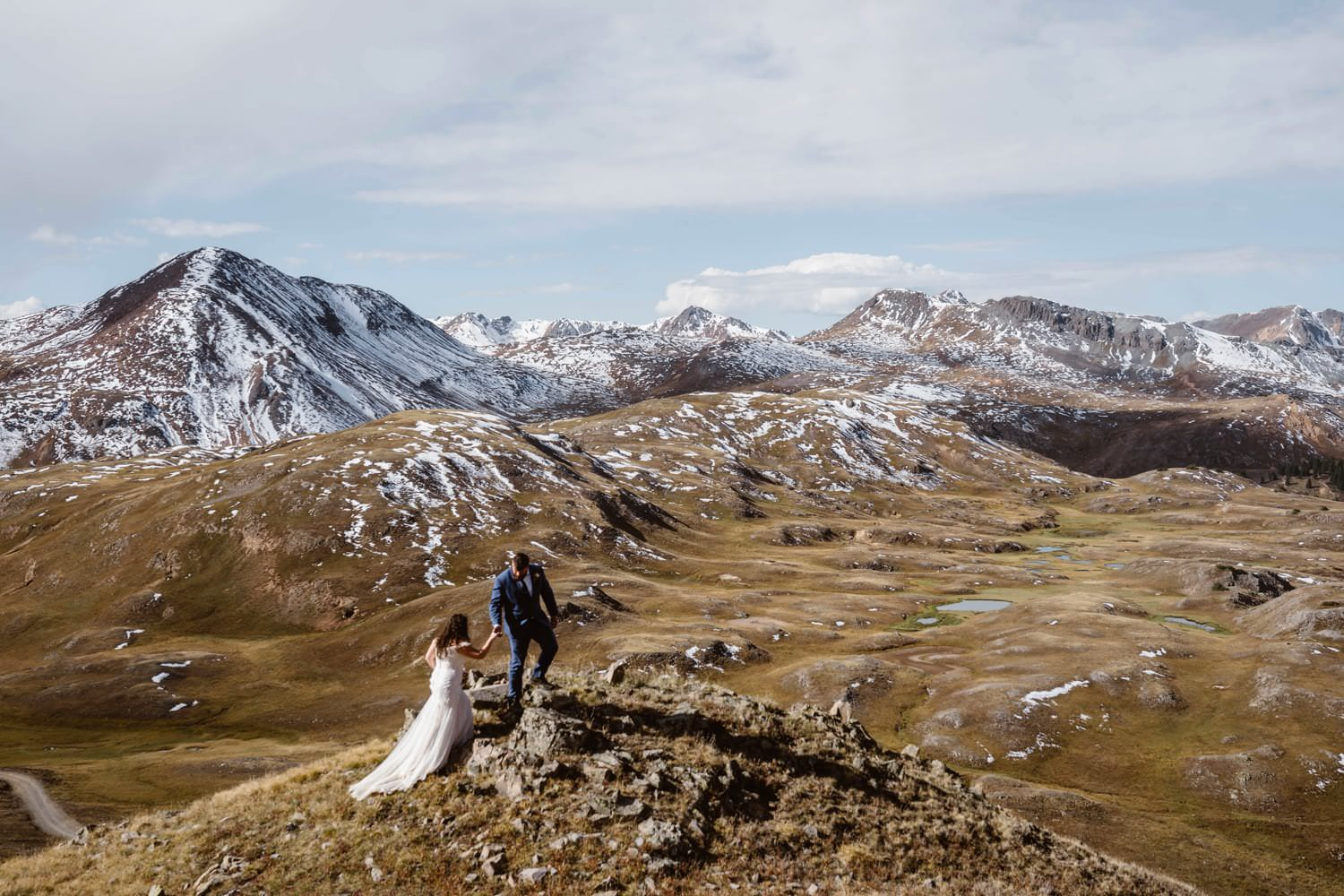 Bride and Groom Hiking at Silverton, CO Elopement