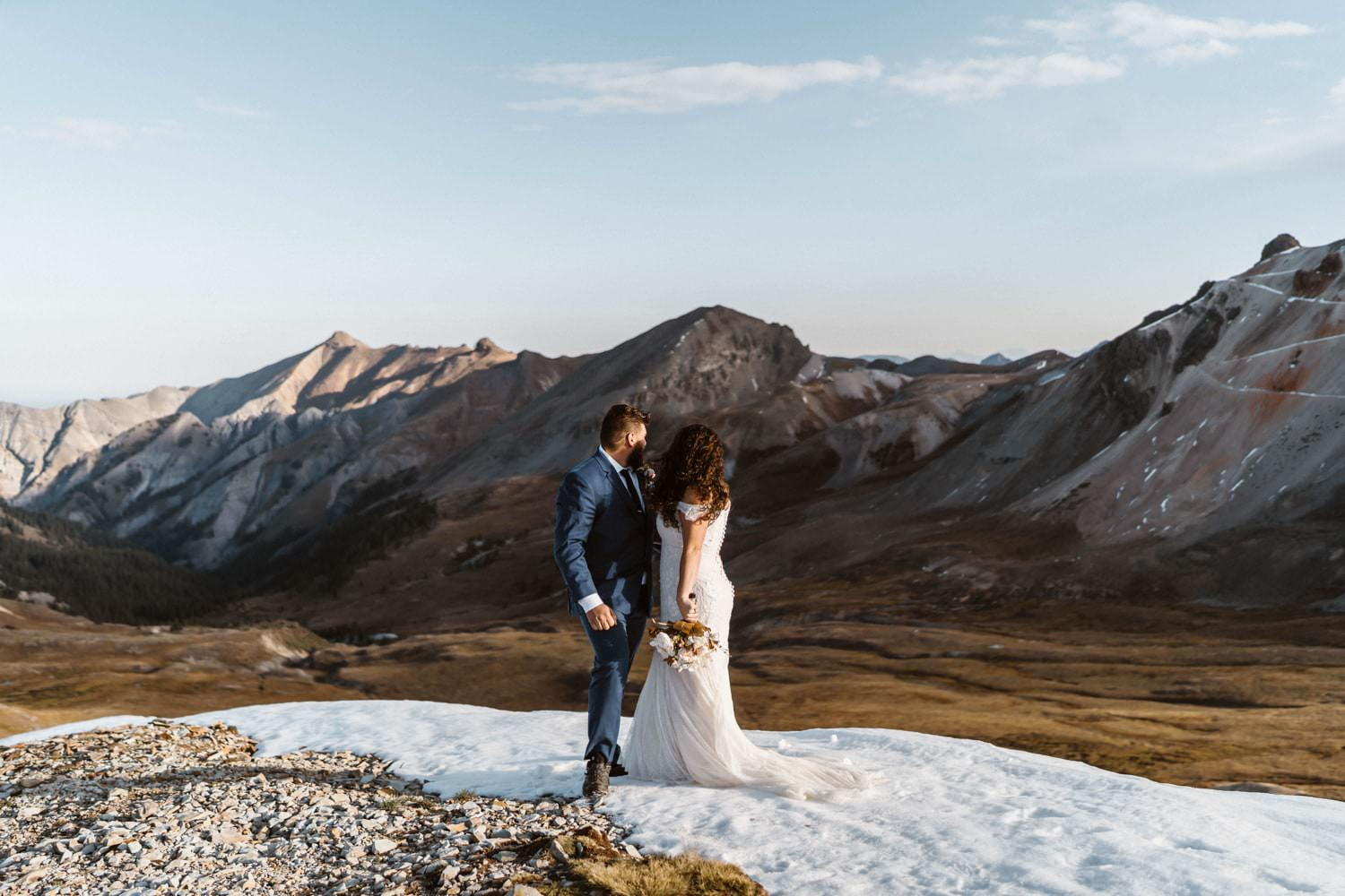 Bride and Groom Looking Off at Silverton, CO Elopement