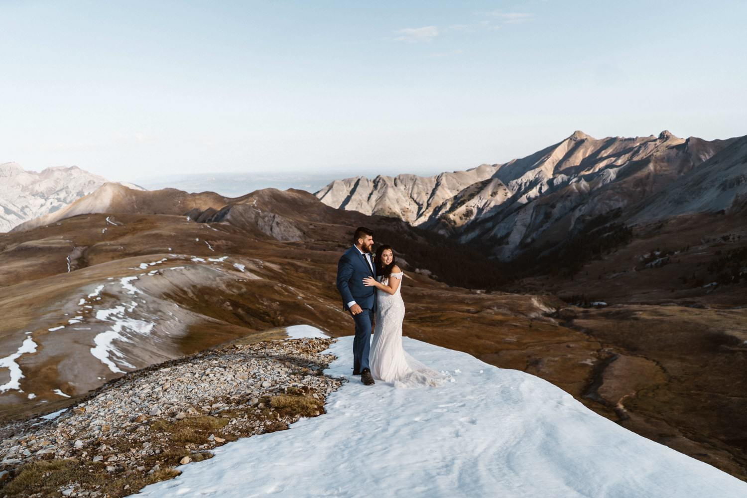 Bride and Groom in Snow Patch at Silverton, CO Elopement