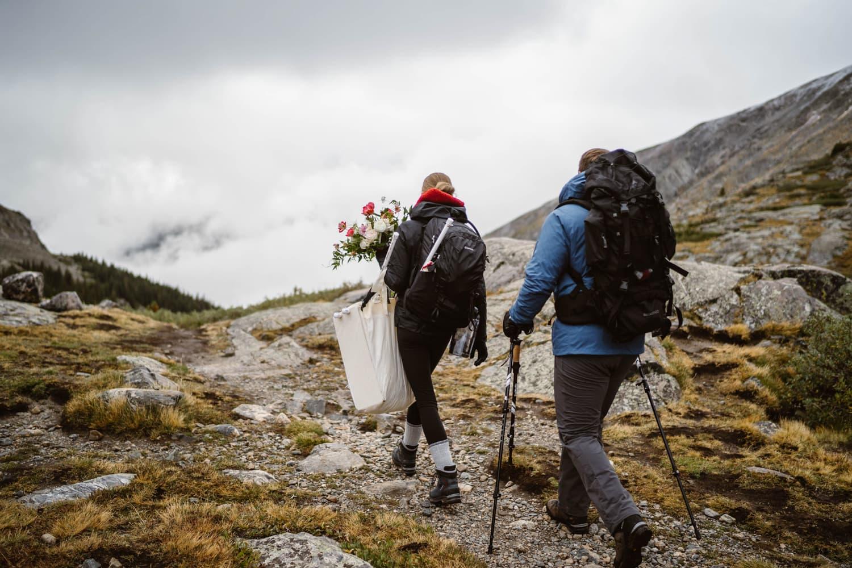 Bride and Groom In Fog Hiking Adventure Elopement