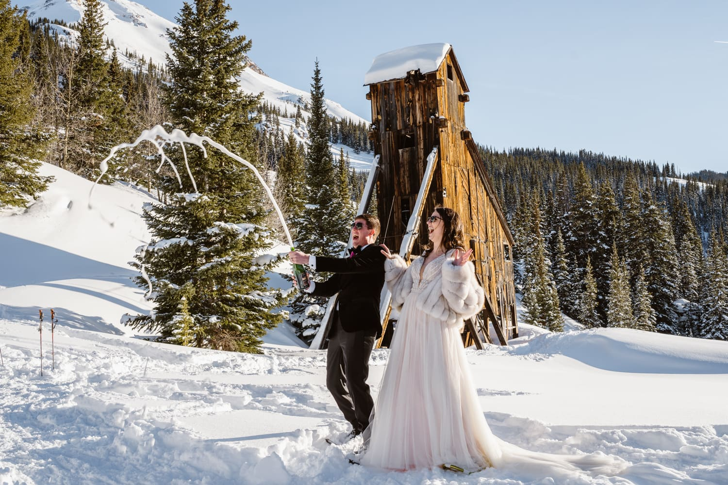 Bride and Groom Spraying Champagne Telluride Elopement Packages