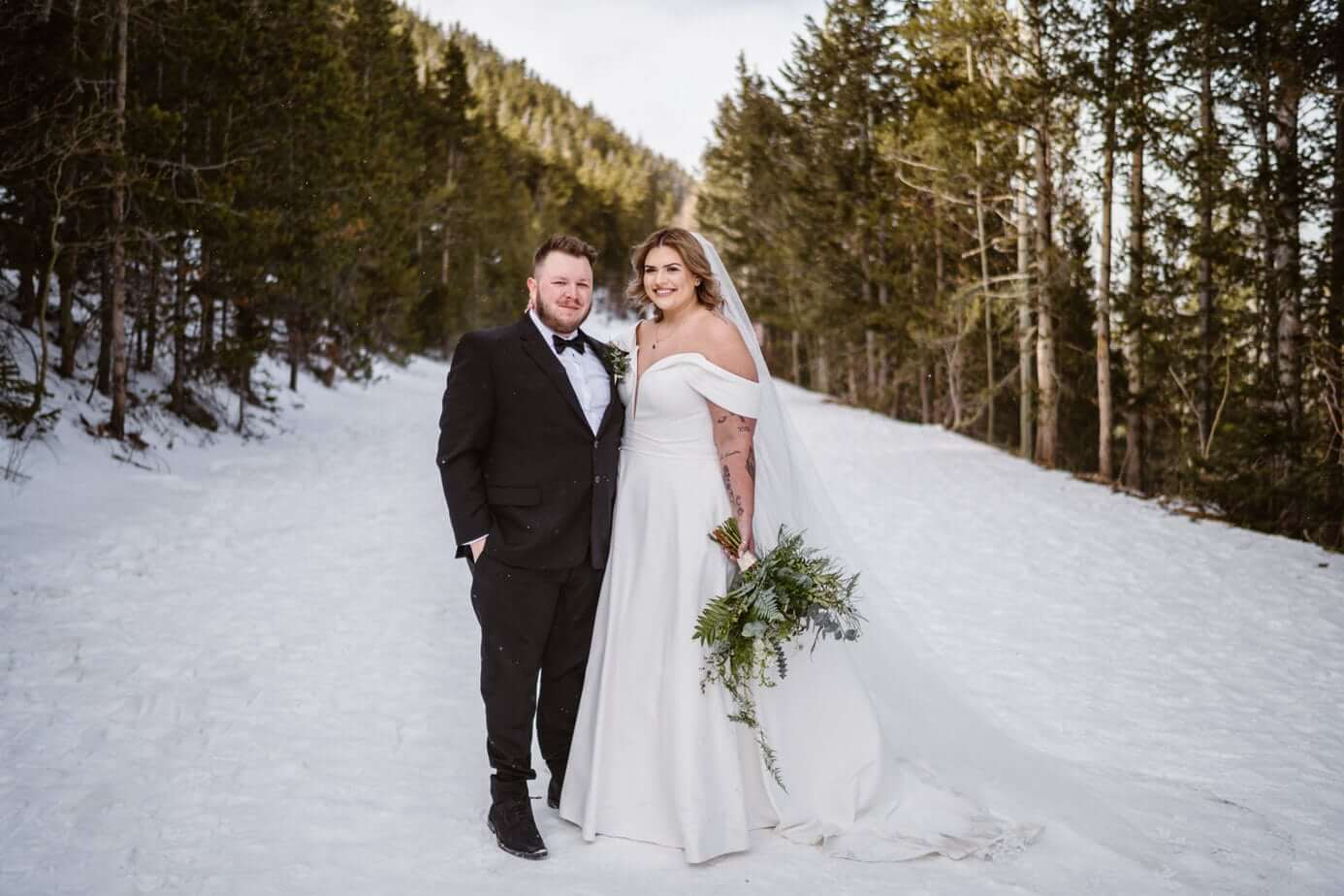 Bride and Groom in the Snow Winter Elopement Guide