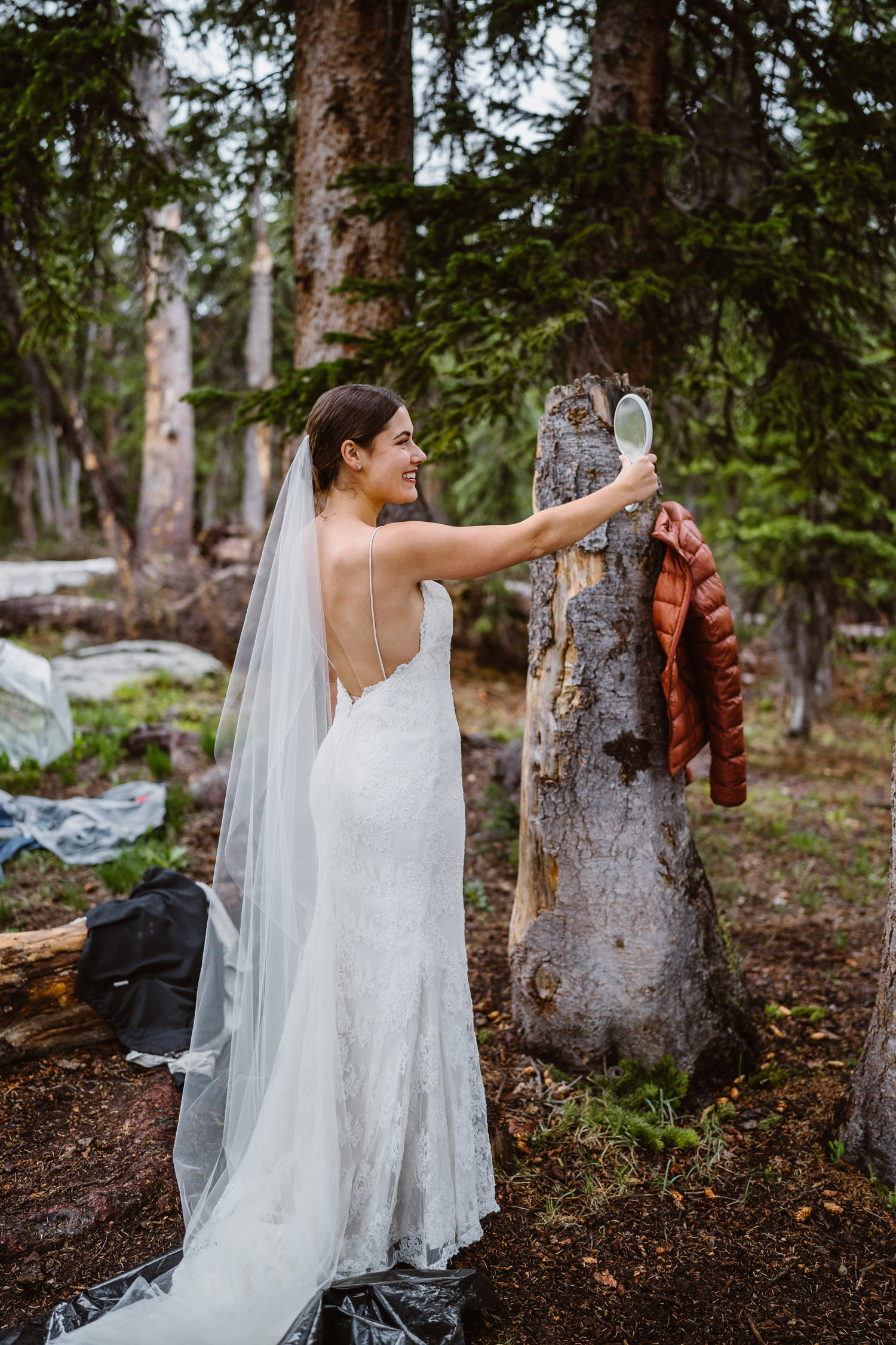 Bride Getting Ready for Hiking Elopement